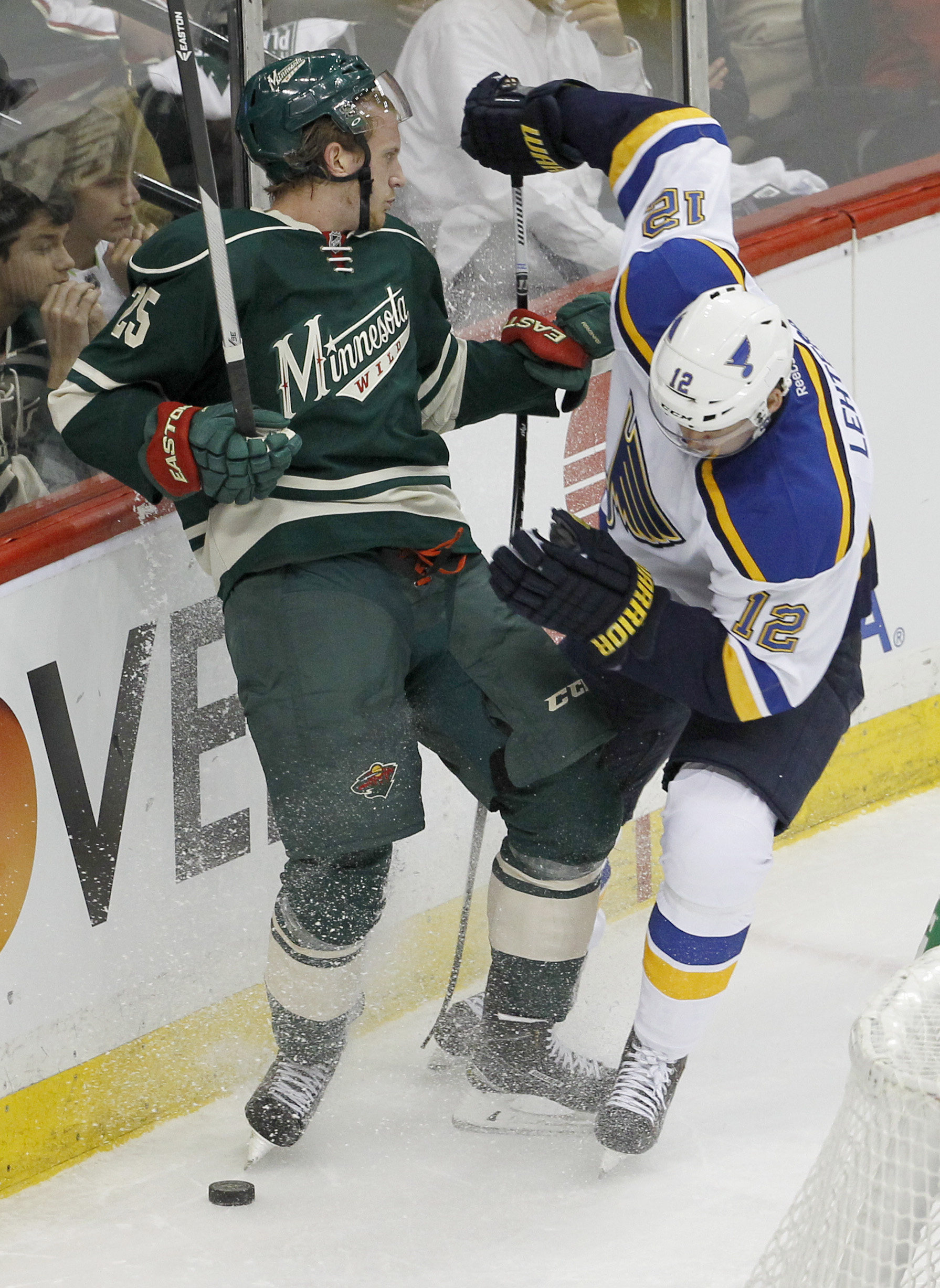 Minnesota Wild defenseman Jonas Brodin (25) and St. Louis Blues center Jori Lehtera (12), of Finland, battle for the puck during the first period of Game 3 of an NHL hockey first-round playoff series game in St. Paul, Minn., Monday, April 20, 2015. (AP Ph