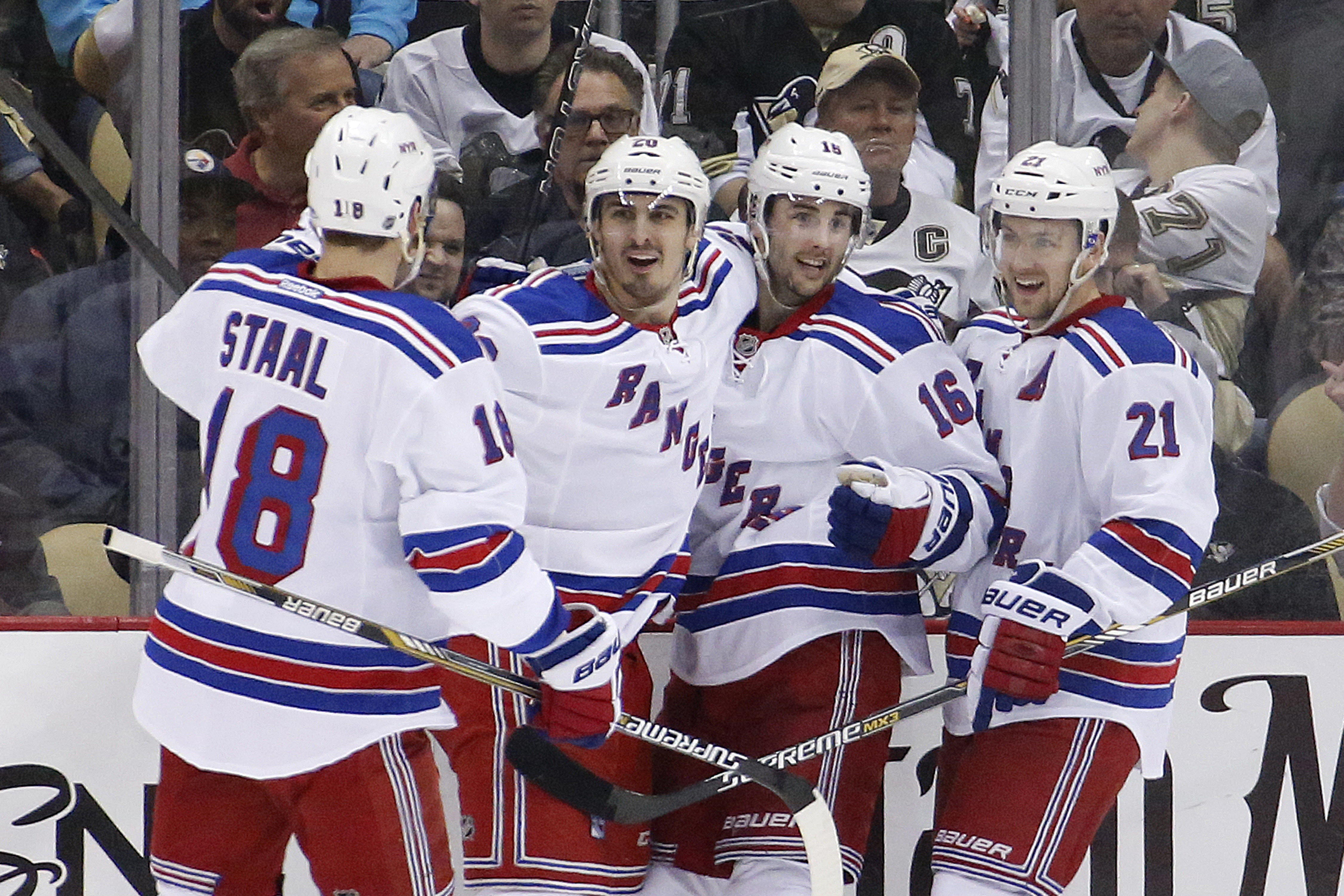 New York Rangers' Chris Kreider (20) celebrates with teammates after his goal during the second period of a first-round NHL playoff hockey game against the Pittsburgh Penguins in Pittsburgh Monday, April 20, 2015.(AP Photo/Gene J. Puskar)