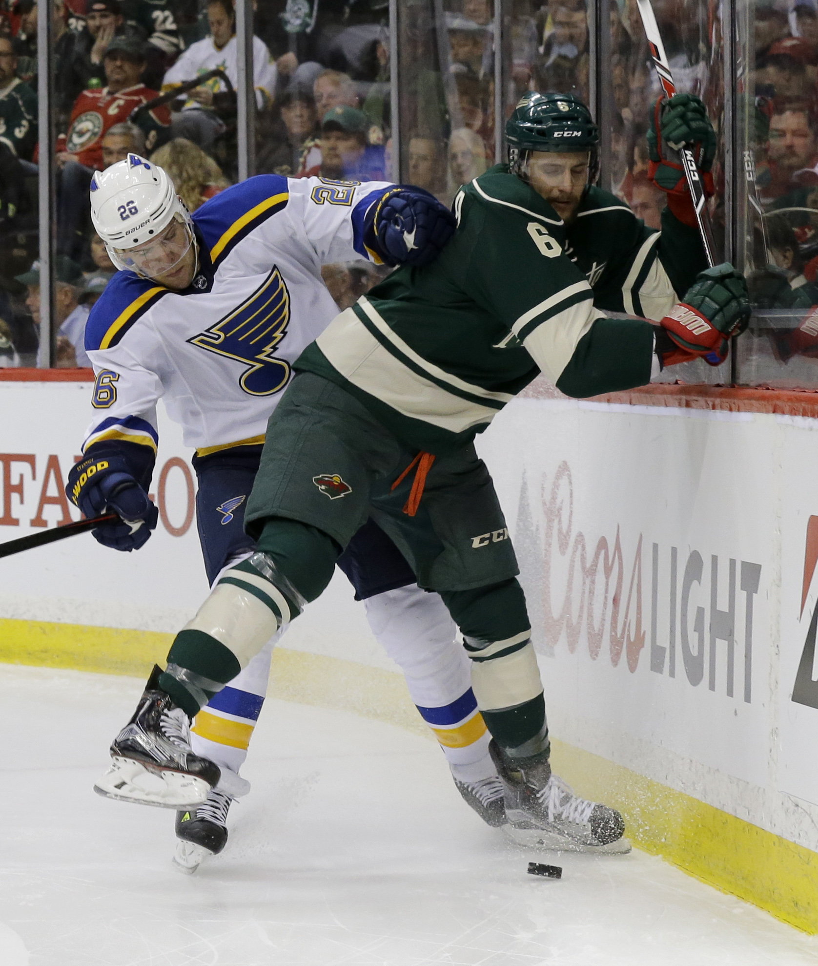 Minnesota Wild defenseman Marco Scandella (6) and St. Louis Blues center Paul Stastny (26) battle for the puck during the second period of Game 3 of an NHL hockey first-round playoff series game in St. Paul, Minn., Monday, April 20, 2015. (AP Photo/Ann He