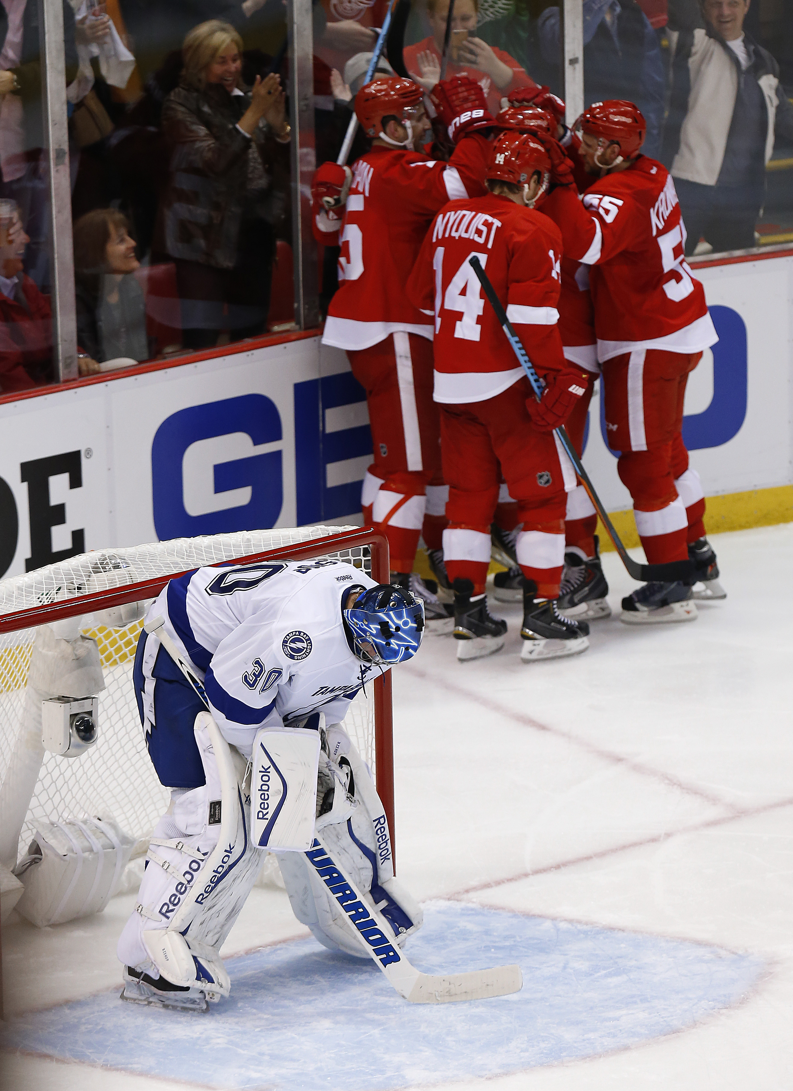 Detroit Red Wings center Riley Sheahan (15) celebrates his goal with teammates as Tampa Bay Lightning goalie Ben Bishop stands in the goal during the third period of Game 3 of a first-round NHL Stanley Cup hockey playoff series  in Detroit Tuesday, April