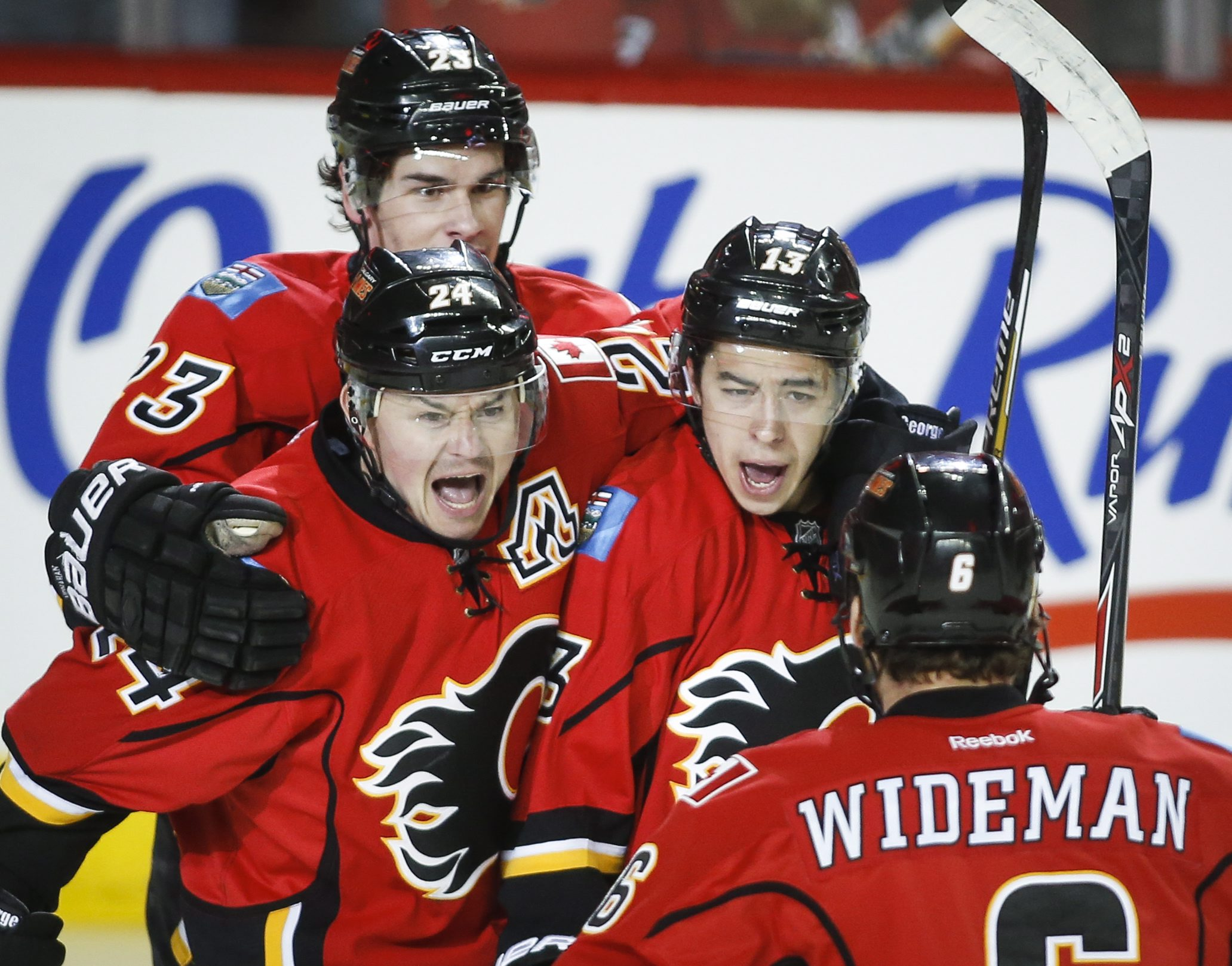 Calgary Flames' Johnny Gaudreau, center right, celebrates his goal with against the Vancouver Canucks with teammates Sean Monahan, left, Jiri Hudler, center left, from the Czech Republic and Dennis Wideman during the first period of Game 4 of a first-roun