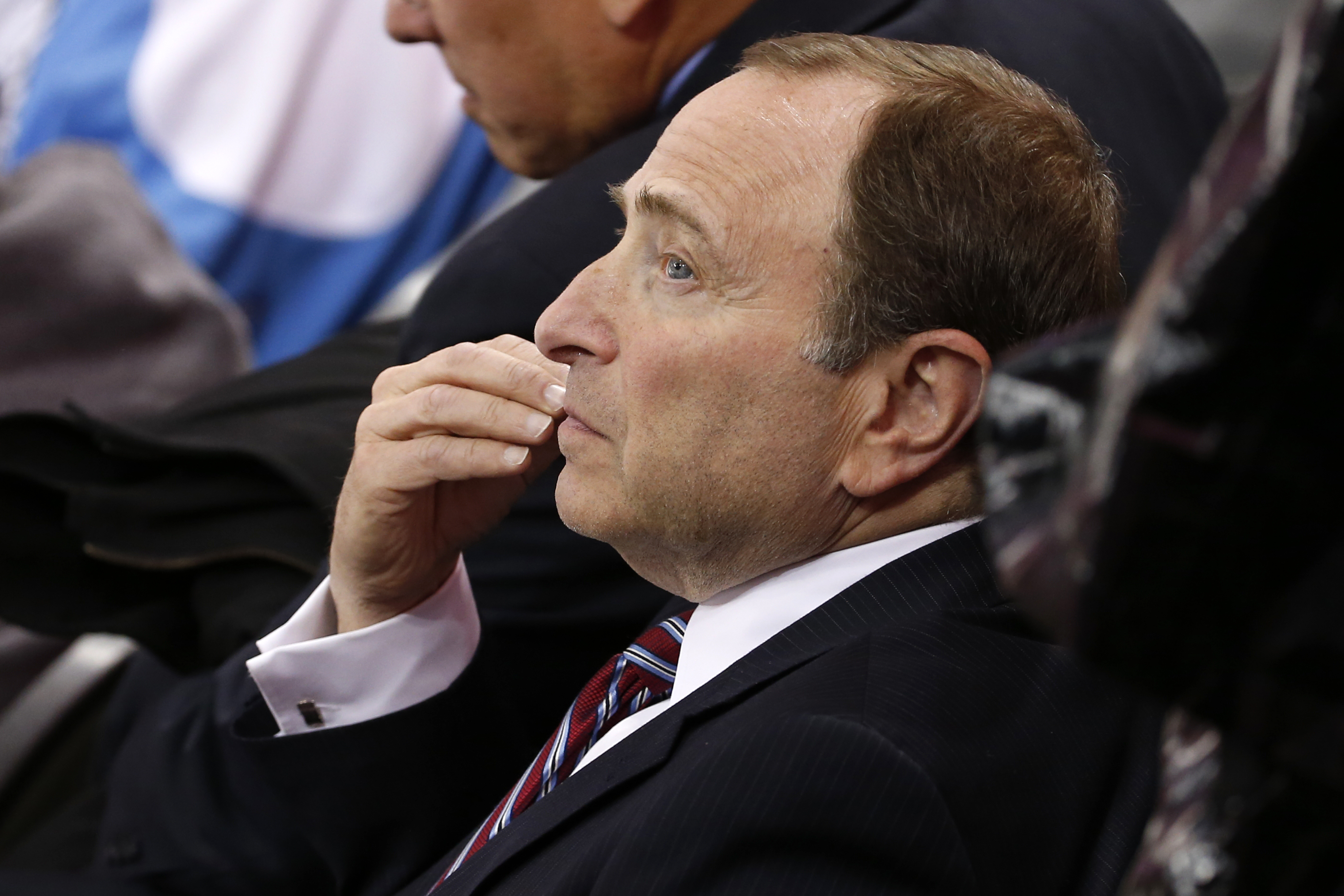 NHL commissioner Gary Bettman watches the first period of a first-round NHL playoff hockey game between the Pittsburgh Penguins and the New York Rangers in Pittsburgh on Wednesday, April 22, 2015.(AP Photo/Gene J. Puskar)