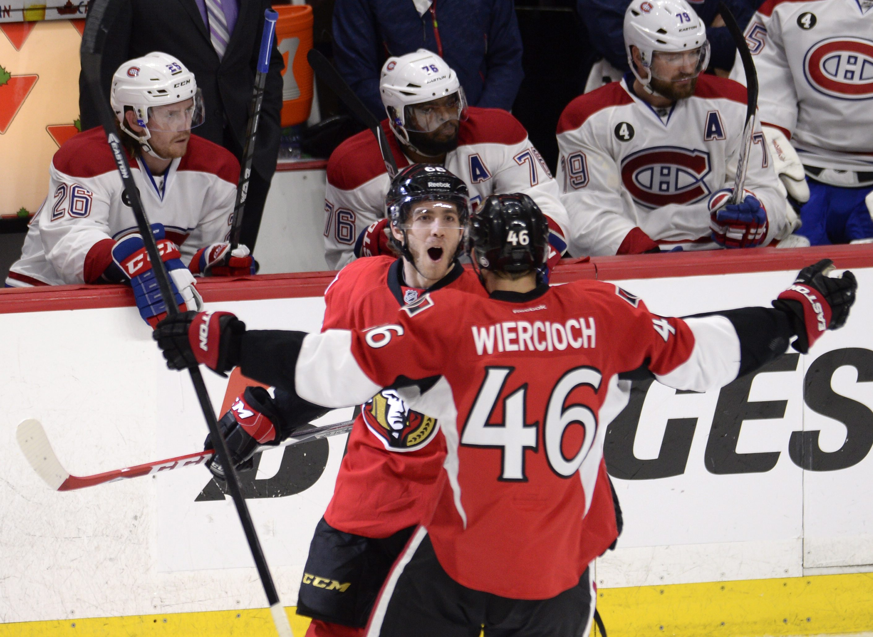 Ottawa Senators' Mike Hoffman (68) celebrates scoring on the Montreal Canadiens with teammate Patrick Wiercioch during the third period in Game 4 of an NHL hockey first-round playoff series, Wednesday, April 22, 2015 in Ottawa, Ontario. (Adrian Wyld/The C