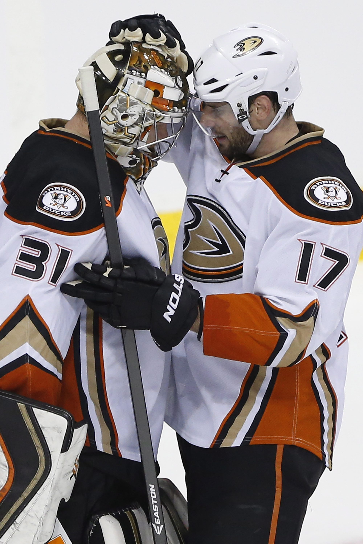 Anaheim Ducks goaltender Frederik Andersen (31) and teammate Ryan Kesler congratulate each other after Game 4 against the Winnipeg Jets in a first-round NHL hockey playoff series, Wednesday, April 22, 2015, in Winnipeg, Manitoba. Anaheim won 5-2 and swept