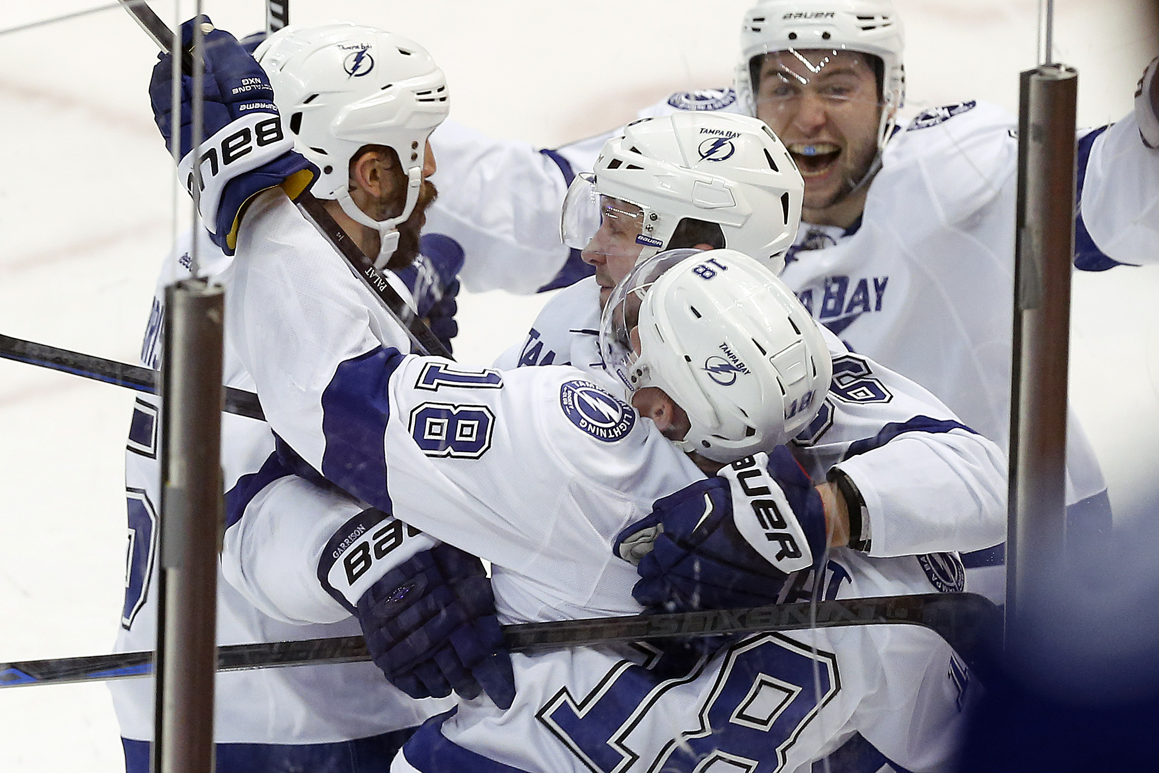 Tampa Bay Lightning left wing Ondrej Palat (18) celebrates his goal against the Detroit Red Wings during the third period of Game 4 of a first-round NHL Stanley Cup hockey playoff series Thursday, April 23, 2015, in Detroit. (AP Photo/Paul Sancya)