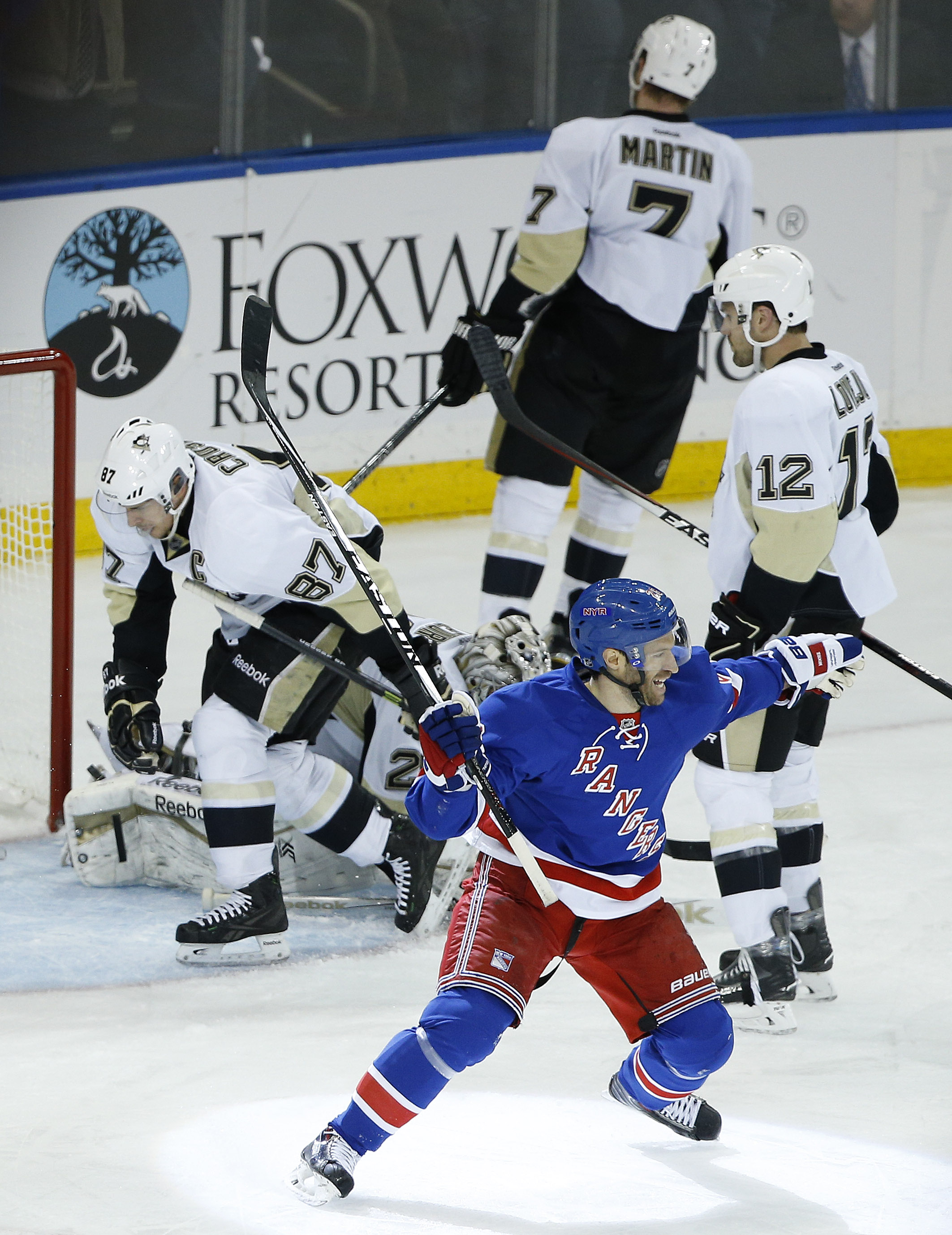 New York Rangers center Dominic Moore (28) reacts after left wing Carl Hagelin scored the winning goal in overtime of Game 5 against the Pittsburgh Penguins in the first round of the NHL hockey Stanley Cup playoffs, Friday, April 24, 2015, in New York. Th