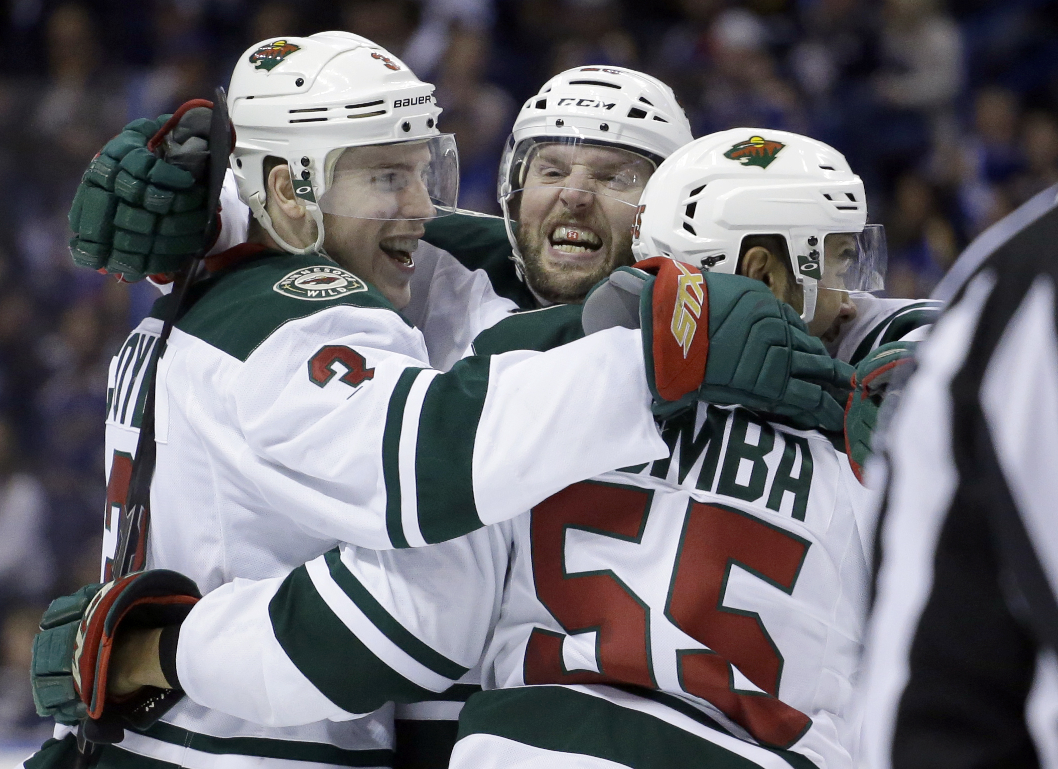 Minnesota Wild's Charlie Coyle, left, is congratulated by teammates Thomas Vanek, of Austria, and Matt Dumba, right, after scoring during the third period in Game 5 of an NHL hockey first-round playoff series against the St. Louis Blues, Friday, April 24,