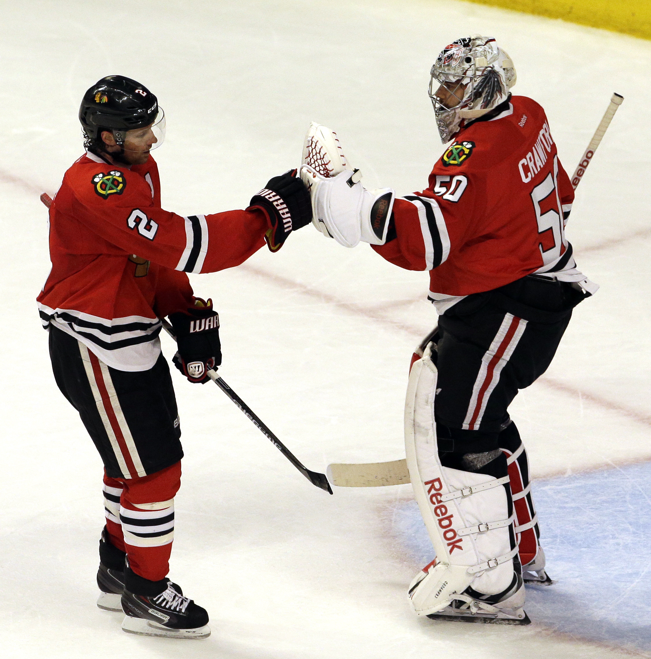 Chicago Blackhawks defenseman Duncan Keith, left, celebrates with goalie Corey Crawford after scoring his goal against the Nashville Predators during the third period in Game 6 of an NHL Western Conference hockey playoff series Saturday, April 25, 2015, i