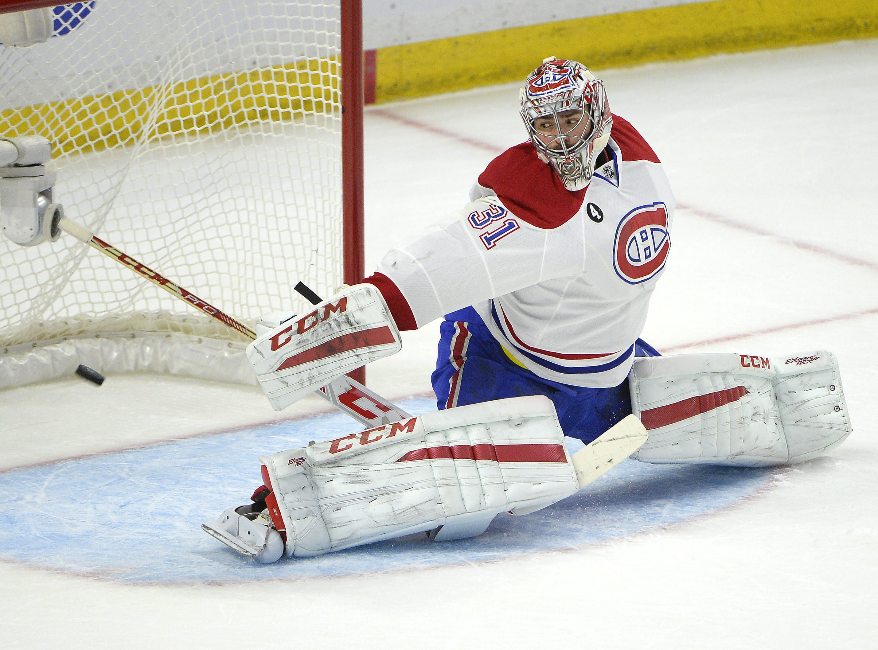 Montreal Canadiens' Carey Price (31) makes a save against Ottawa Senators' Kyle Turris during the first period of Game 6 of a first-round NHL hockey playoff series Sunday April 26, 2015, in Ottawa, Ontario. (Justin Tang/The Canadian Press via AP)   MANDAT