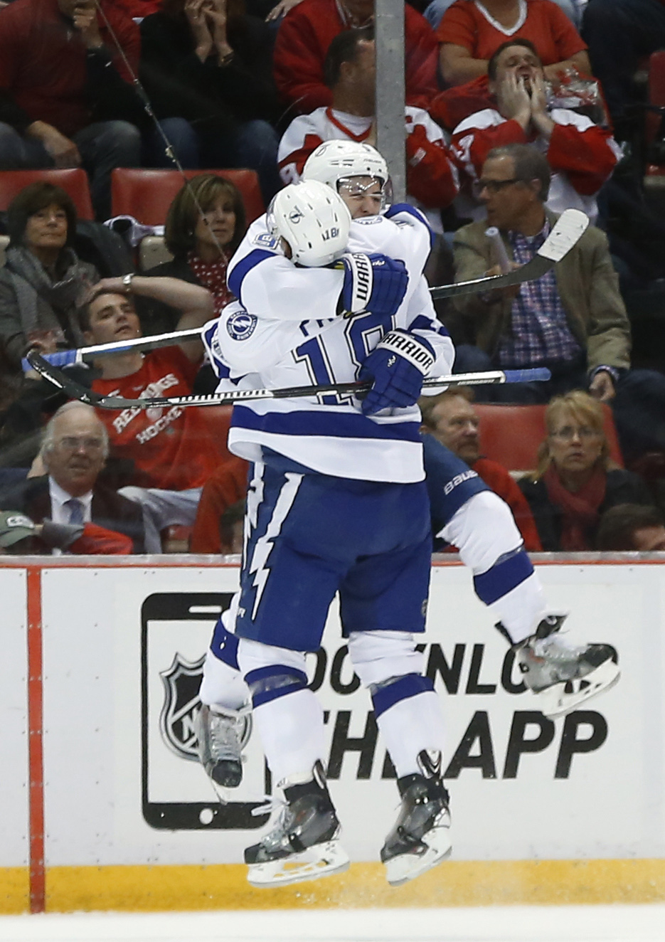 Tampa Bay Lightning center Tyler Johnson, facing, celebrates his goal against the Detroit Red Wings with Ondrej Palat in the second period of Game 6 of a first-round NHL Stanley Cup hockey playoff series, Monday, April 27, 2015, in Detroit. (AP Photo/Paul