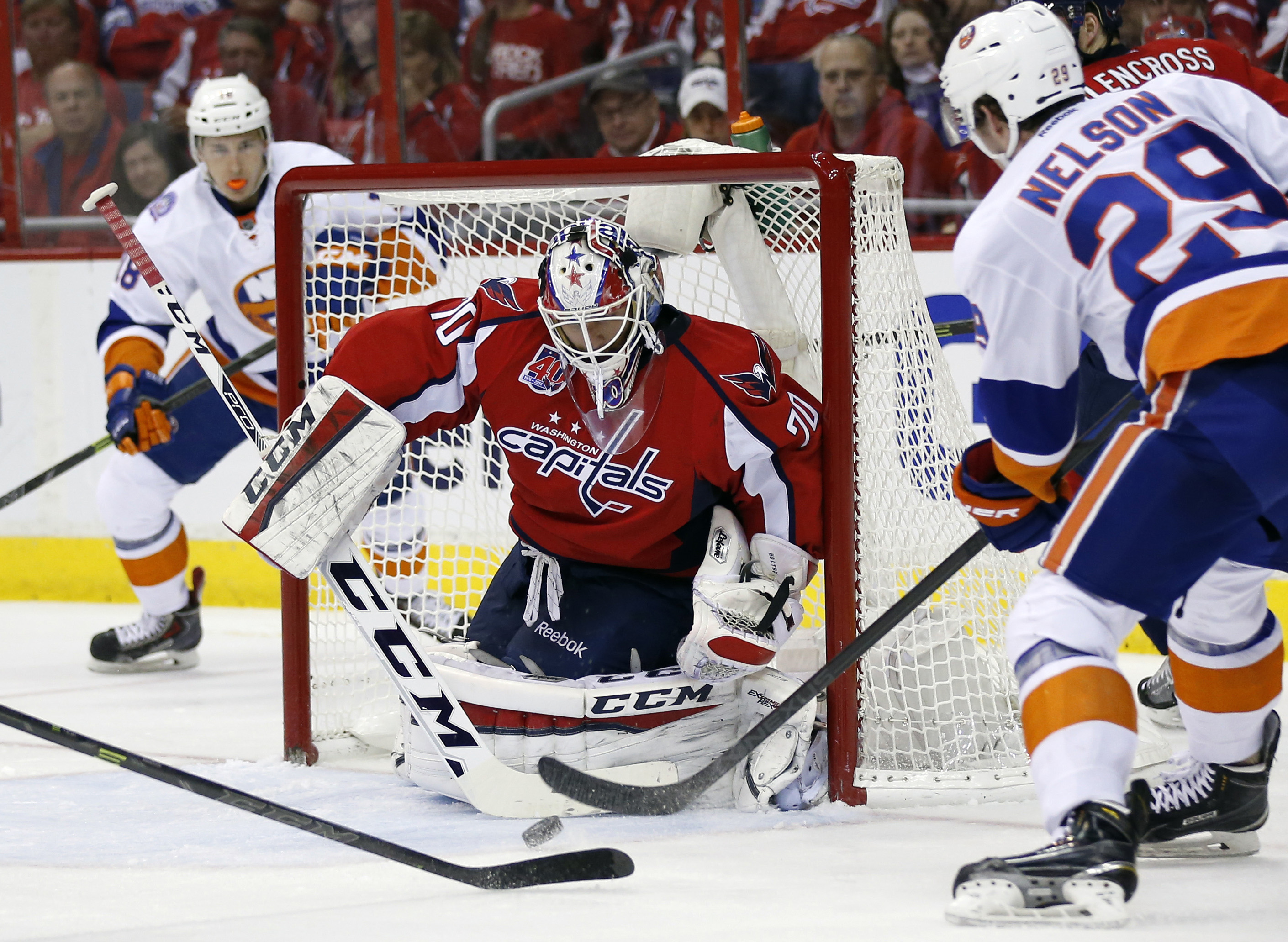 Washington Capitals goalie Braden Holtby (70) blocks a shot by New York Islanders center Brock Nelson (29) during the second period of Game 7 in the first round of the NHL hockey Stanley Cup playoffs, Monday, April 27, 2015, in Washington. (AP Photo/Alex