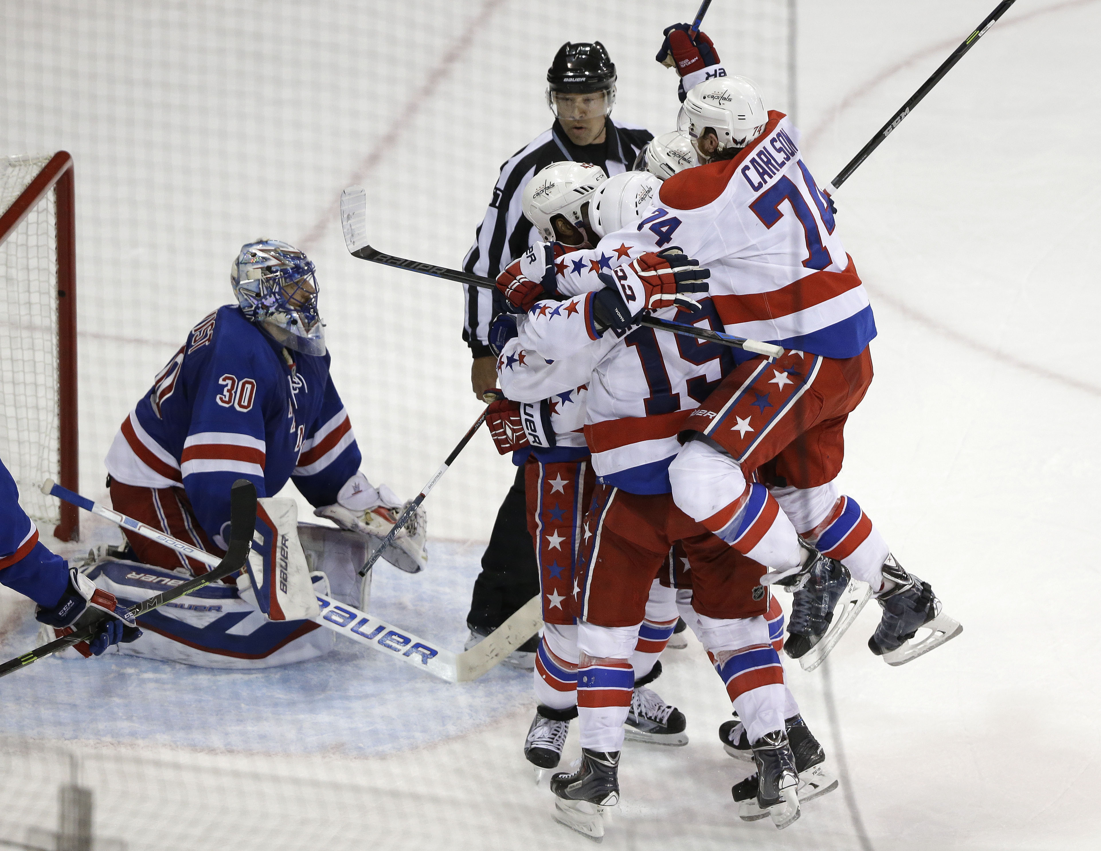 RETRANSMISSION TO CORRECT GOAL BY JOEL WARD - The Washington Capitals celebrate a goal by right wing Joel Ward as New York Rangers goalie Henrik Lundqvist (30) looks on during the third period of Game 1 in the second round of the NHL Stanley Cup hockey pl