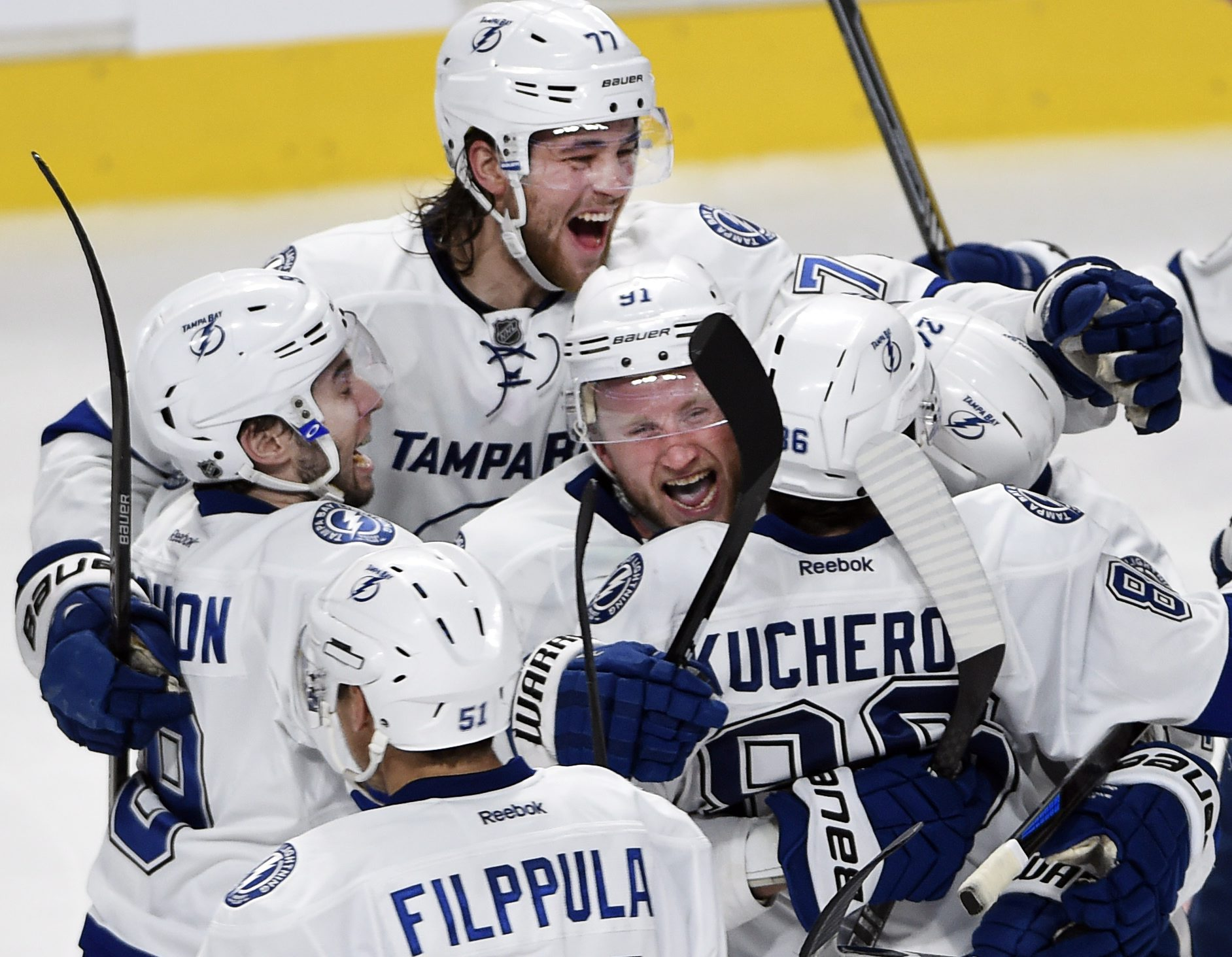 Tampa Bay Lightning right wing Nikita Kucherov (86) is hugged by Lightning center Steven Stamkos (91) as he celebrates with teammates after scoring the winning goal during the second overtime against the Montreal Canadiens of Game 1 of second-round playof
