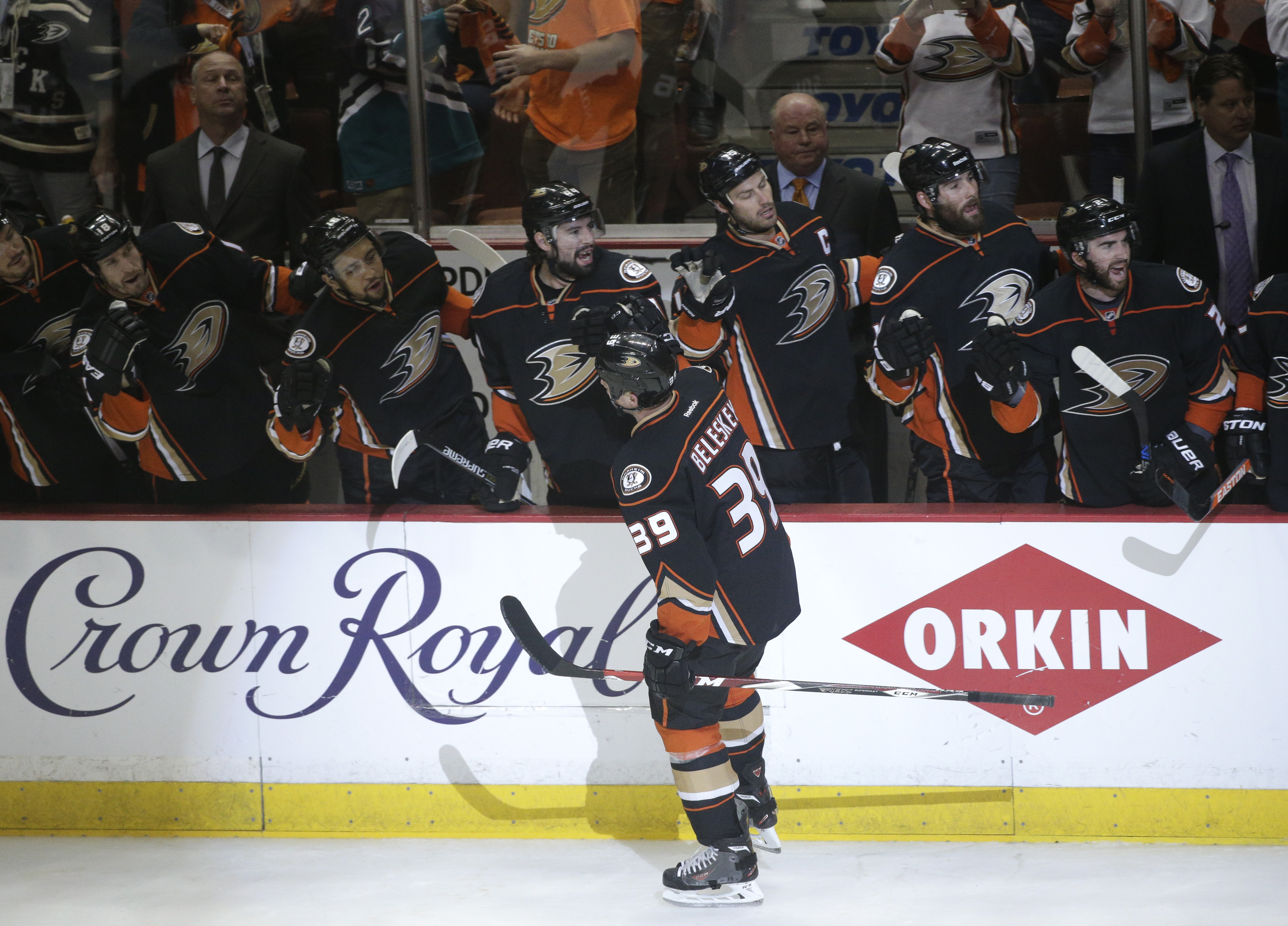Anaheim Ducks' Matt Beleskey, center, celebrates his goal with teammates during the first period of Game 2 in the second round of the NHL Stanley Cup hockey playoffs against the Calgary Flames, Sunday, May 3, 2015, in Anaheim, Calif. (AP Photo/Jae C. Hong