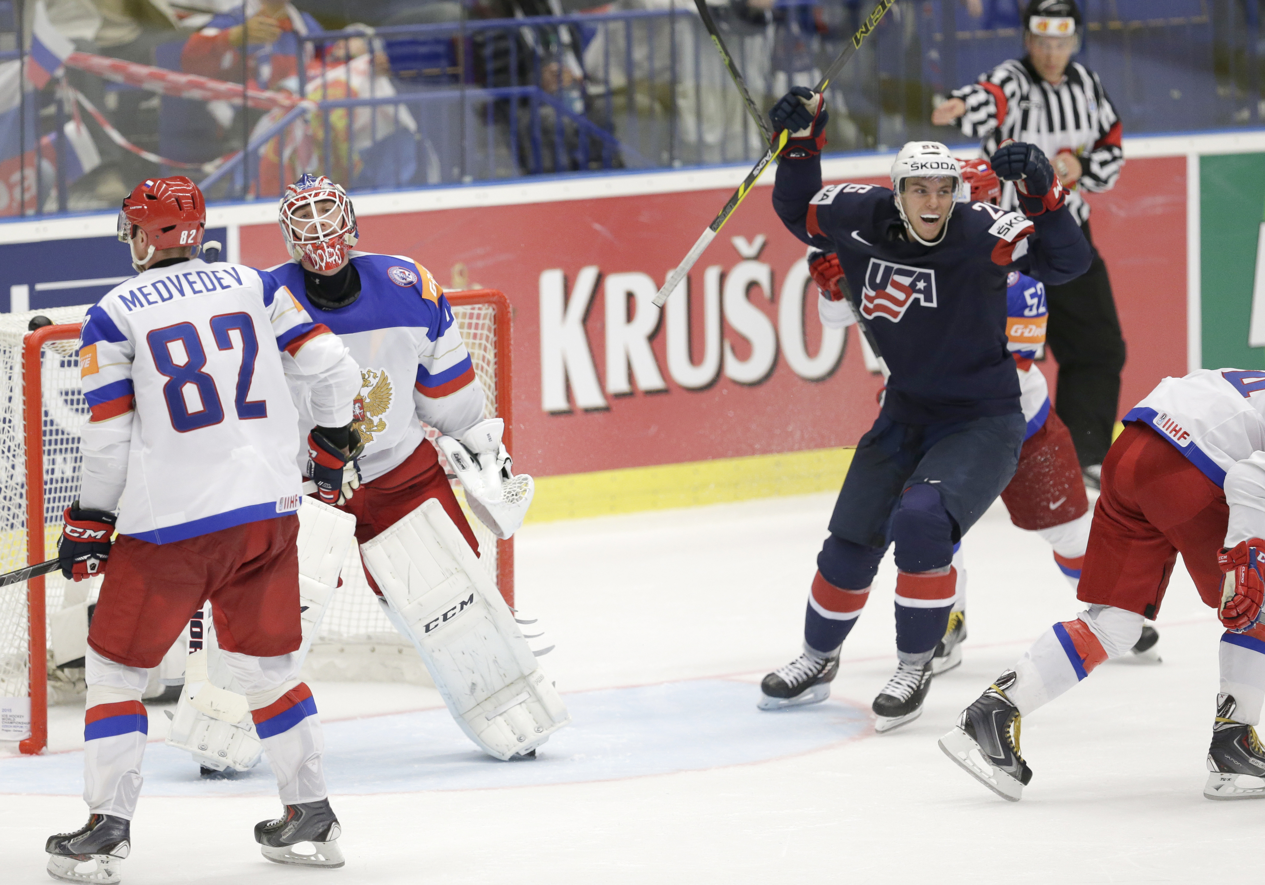 Russia's goalkeeper Sergei Bobrovski is dejected as Jeremy Morin of USA, right celebrates during the Hockey World Championships Group B match in Ostrava, Czech Republic, Monday, May 4, 2015. (AP Photo/Sergei Grits)
