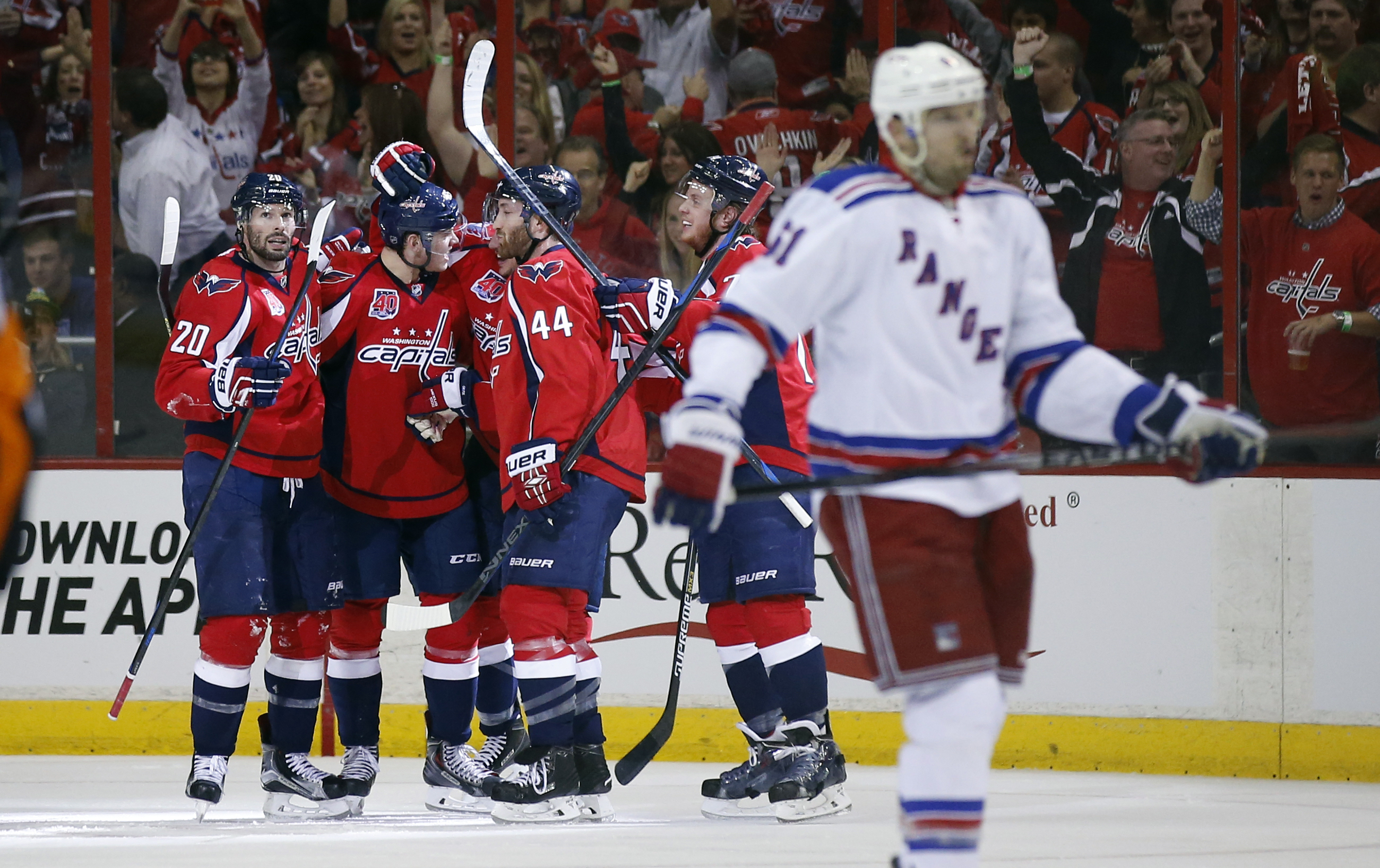 The Washington Capitals celebrate around center Jay Beagle (83) after his goal during the second period of Game 3 in the second round of the NHL Stanley Cup hockey playoffs against the New York Rangers, Monday, May 4, 2015, in Washington. (AP Photo/Alex B