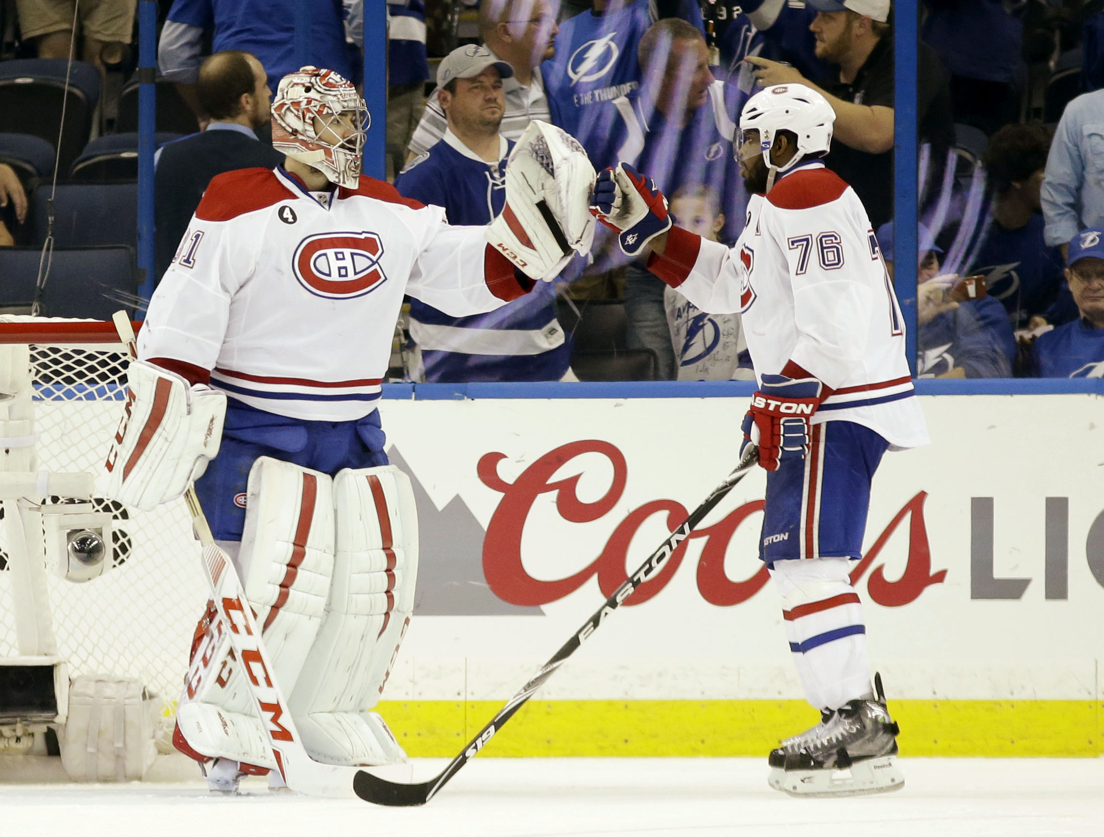 Montreal Canadiens defenseman P.K. Subban, right, and goalie Carey Price, left,  congratulate each other after the Canadiens defeated the Tampa Bay Lightning 6-2 during Game 4 of an NHL second round playoff match, Thursday, May 7, 2015, in Tampa, Fla. (AP