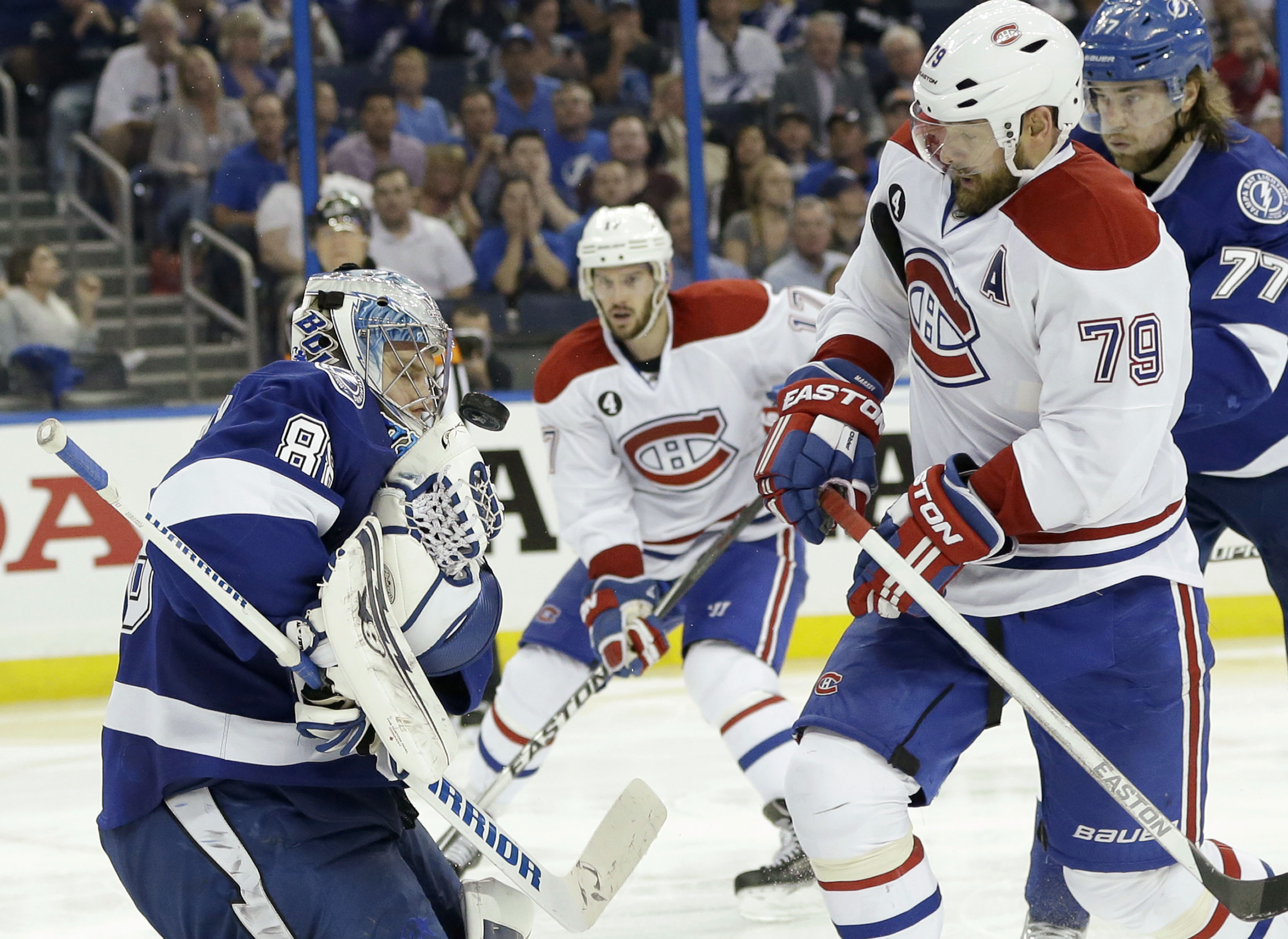 Tampa Bay Lightning goalie Andrei Vasilevskiy, left, of Russia, makes a save against Montreal Canadiens defenseman Andrei Markov, right, of Russia, during third period of Game 4 NHL second round playoff hockey action, Thursday, May 7, 2015, in Tampa, Fla.