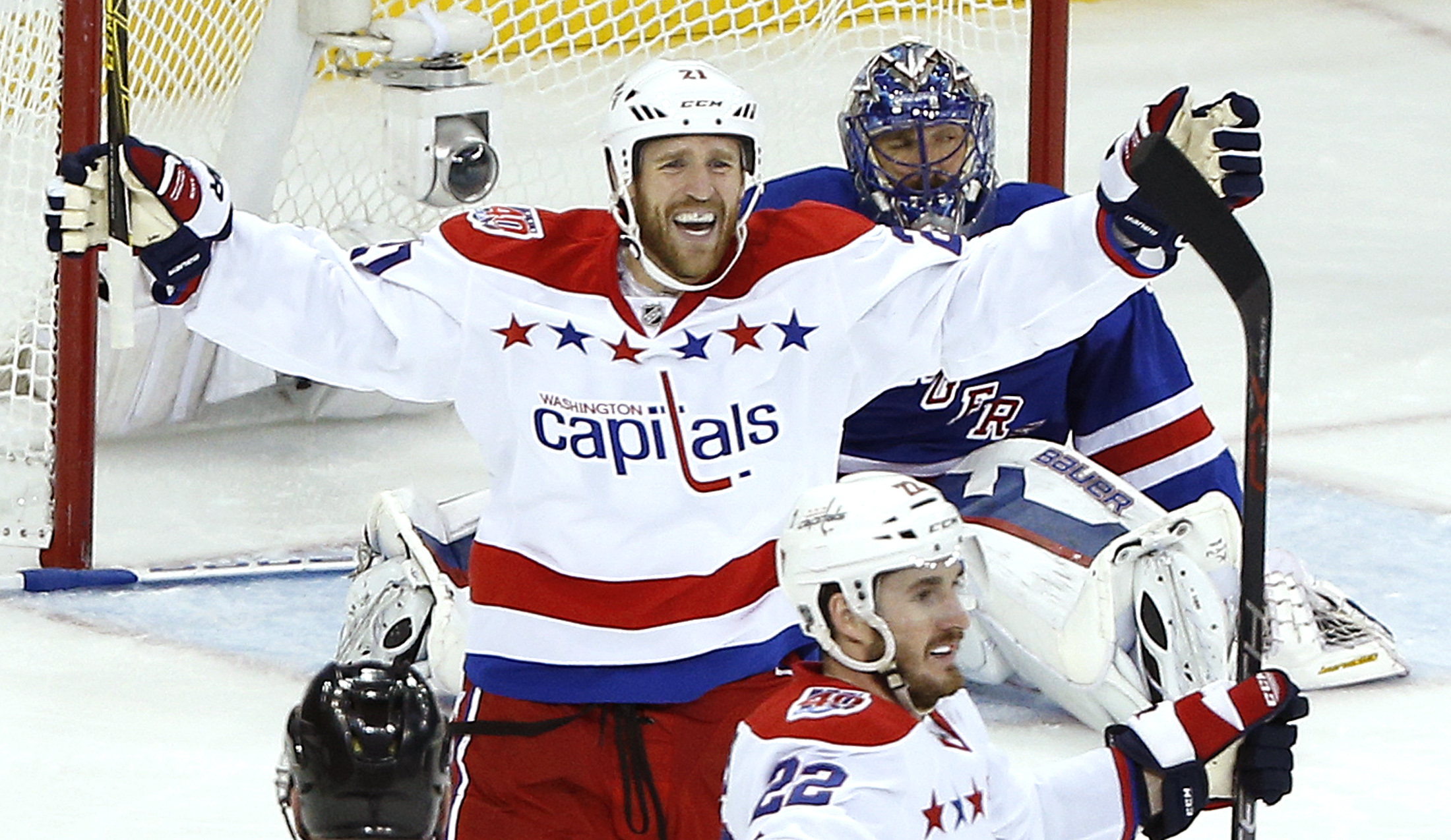 Washington Capitals center Brooks Laich (21) and left wing Curtis Glencross (22) celebrate a third period goal by Glencross against New York Rangers goalie Henrik Lundqvist during Game 5 in the second round of the NHL Stanley Cup hockey playoffs, Friday,