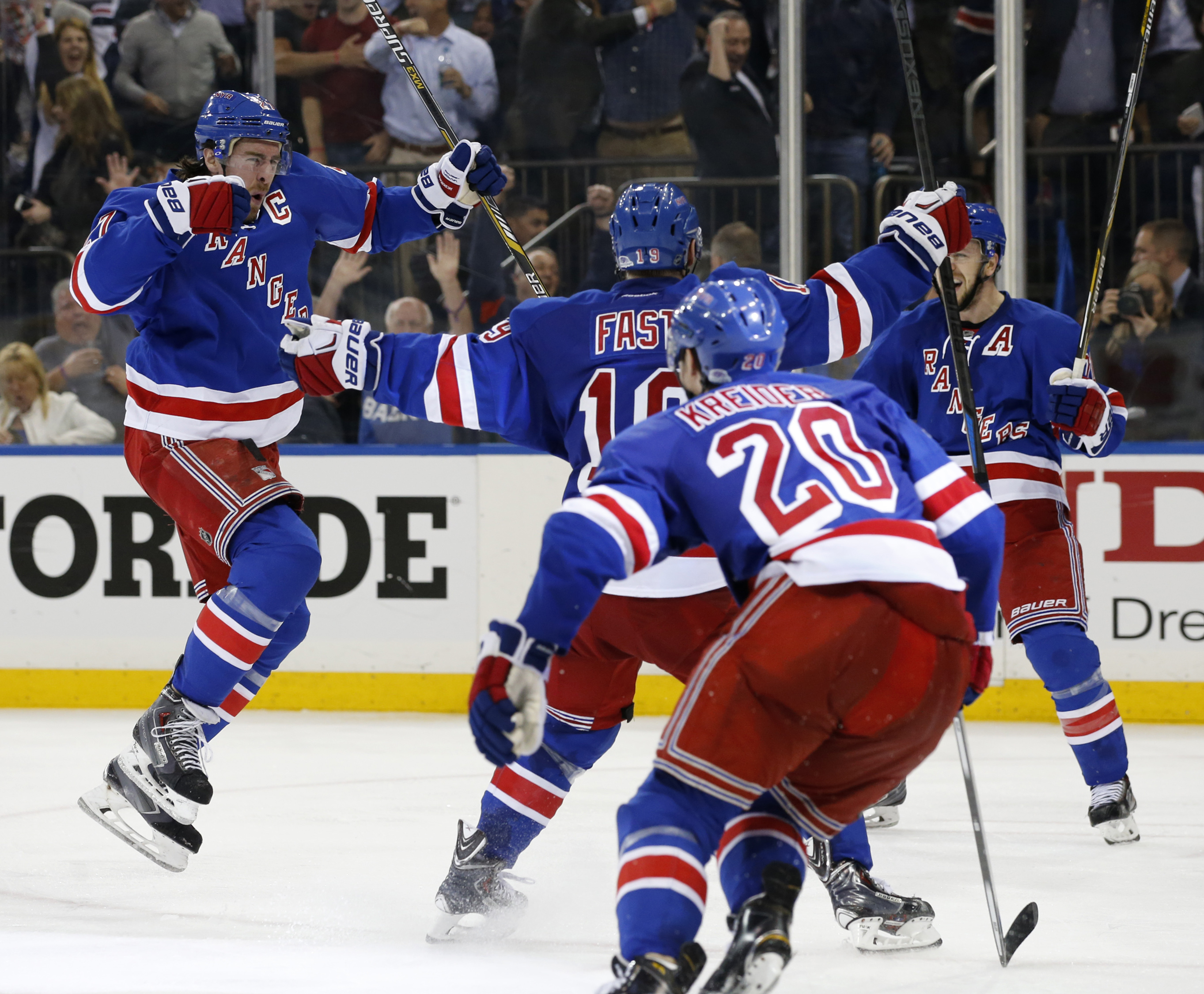 New York Rangers defenseman Ryan McDonagh, left, celebrates after scoring the winning goal in overtime during Game 5 in the second round of the NHL Stanley Cup hockey playoffs, Friday, May 8, 2015, in New York. The Rangers defeated the Capitals 2-1 to ext