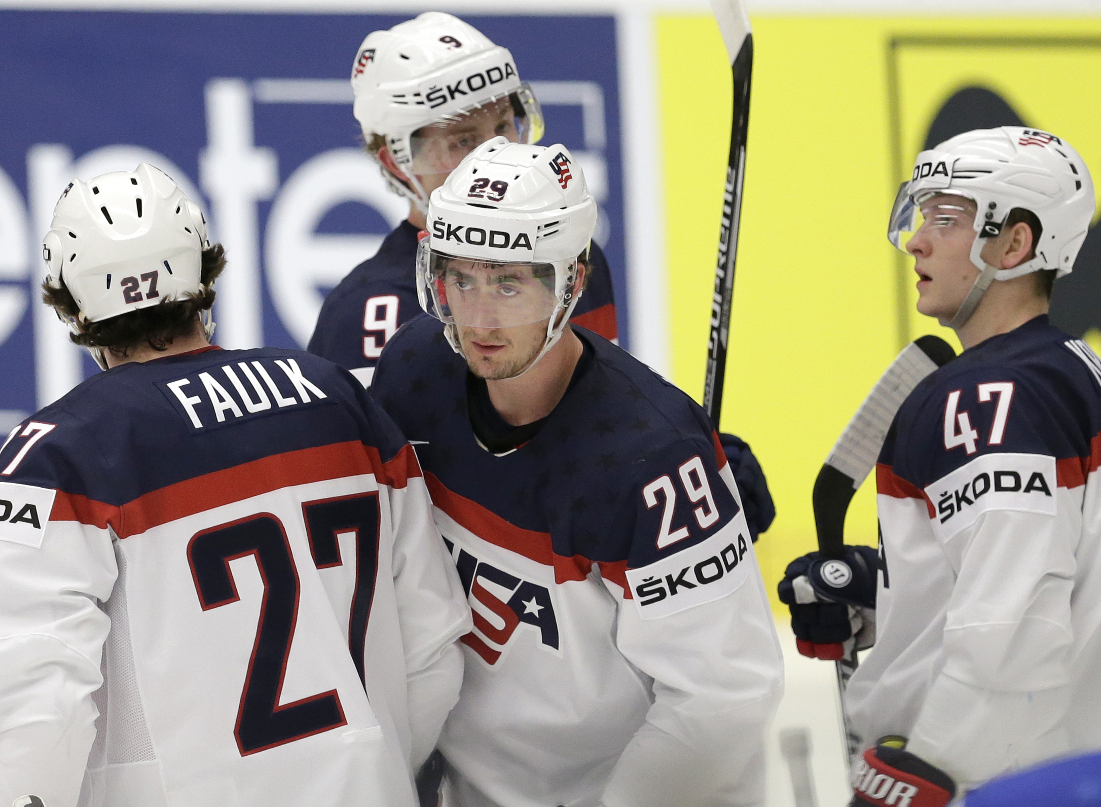 Brock Nelson of USA, second from right, celebrates with team mates after scoring against Slovenia during a Hockey World Championships Group B match in Ostrava, Czech Republic, Sunday, May 10, 2015. (AP Photo/Sergei Grits)