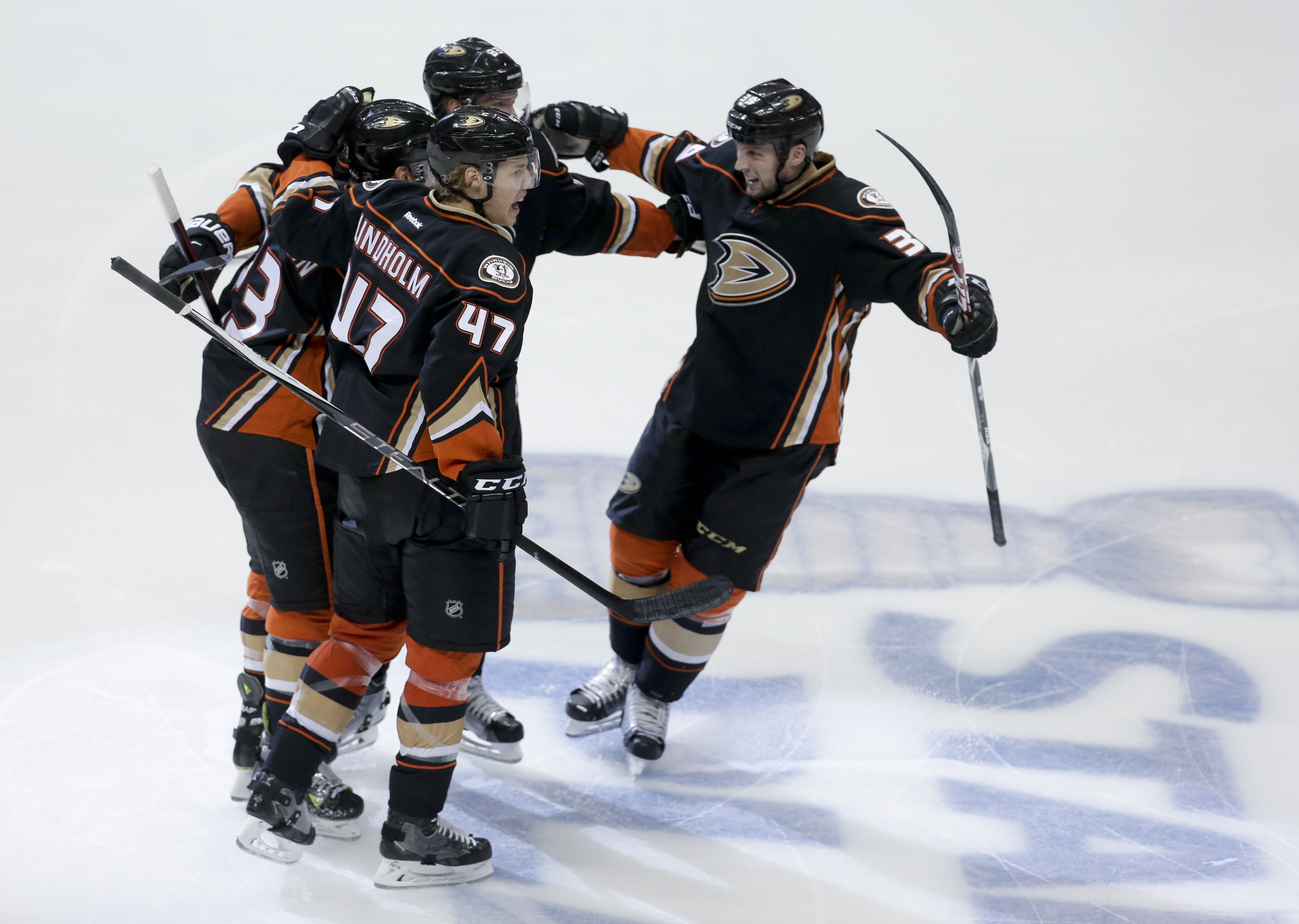 Members of the Anaheim Ducks celebrate Matt Beleskey's goal during the third period of Game 5 in an NHL hockey second-round playoff series against the Calgary Flames in Anaheim, Calif., Sunday, May 10, 2015. (AP Photo/Chris Carlson)