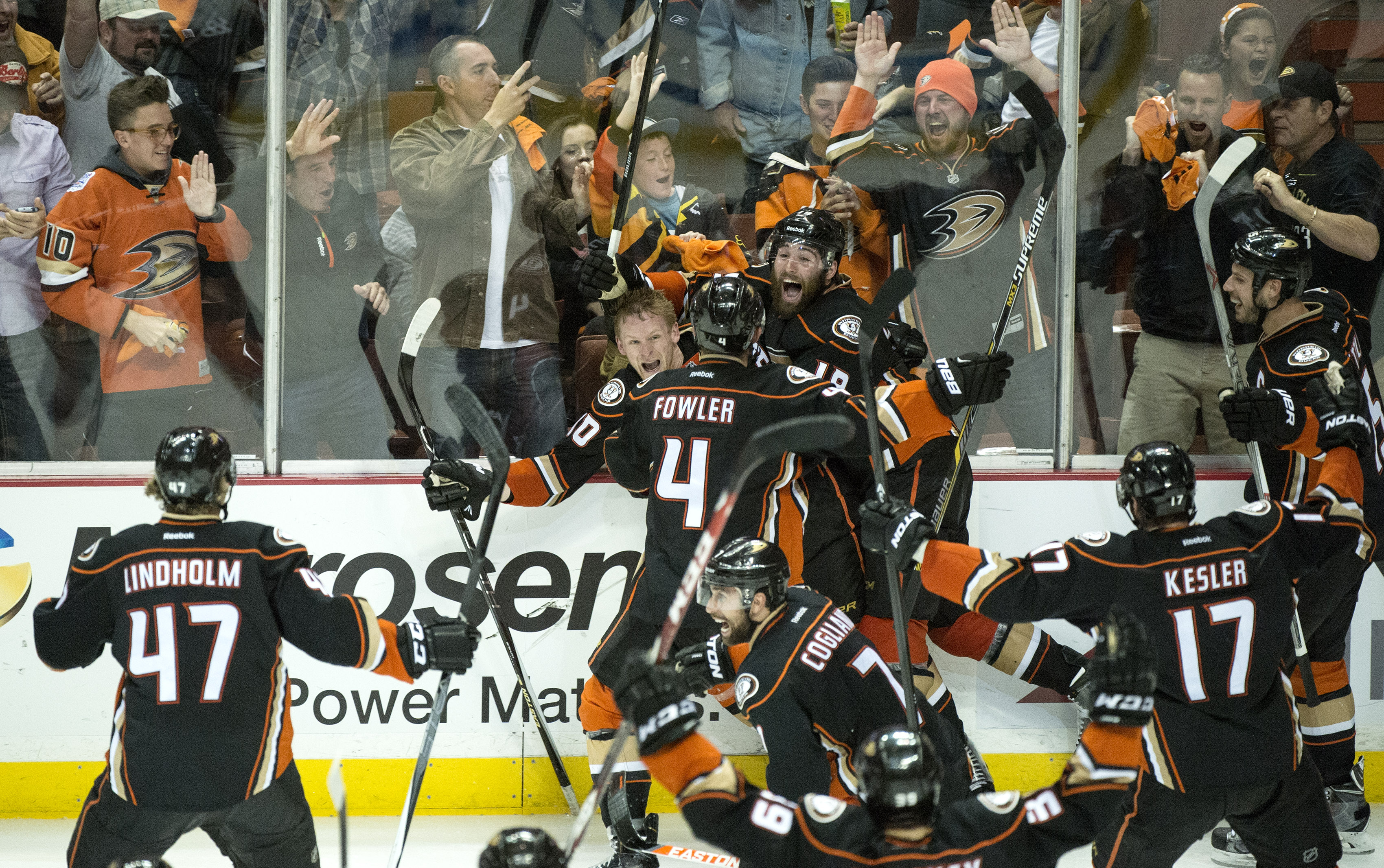 corrects name of the photographerAnaheim Ducks' Corey Perry (10), rear left, celebrates his game-winning goal for a 3-2 overtime win against Calgary in Game 5 of a second-round series in the NHL hockey playoffs in Anaheim, Calif., Sunday, May 10, 2015.  A