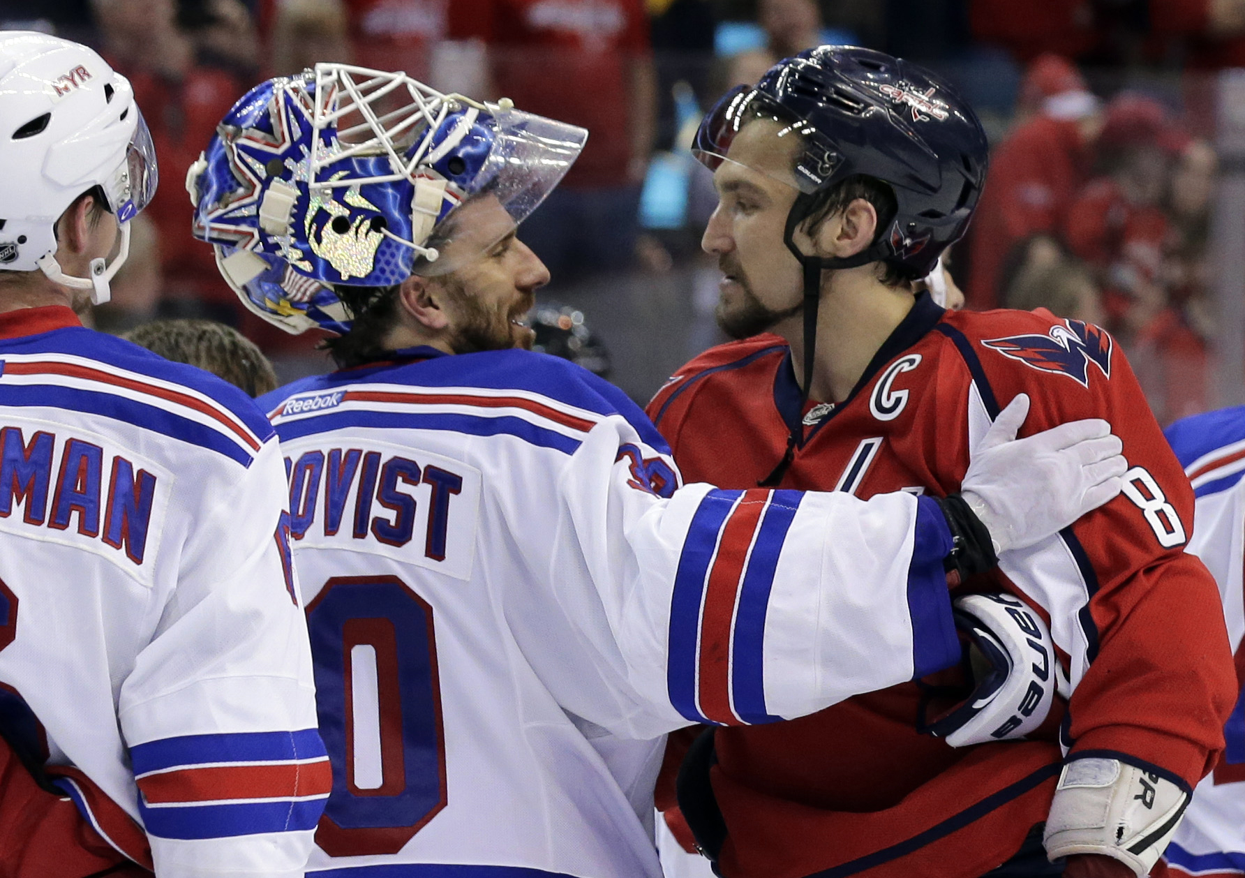 FILE - In this May 13, 2013, file photo, New York Rangers goalie Henrik Lundqvist (30), from Sweden, greets Washington Capitals left wing Alex Ovechkin (8), from Russia, after the Rangers won 5-0 in Game 7 in the first round of the NHL hockey Stanley Cup