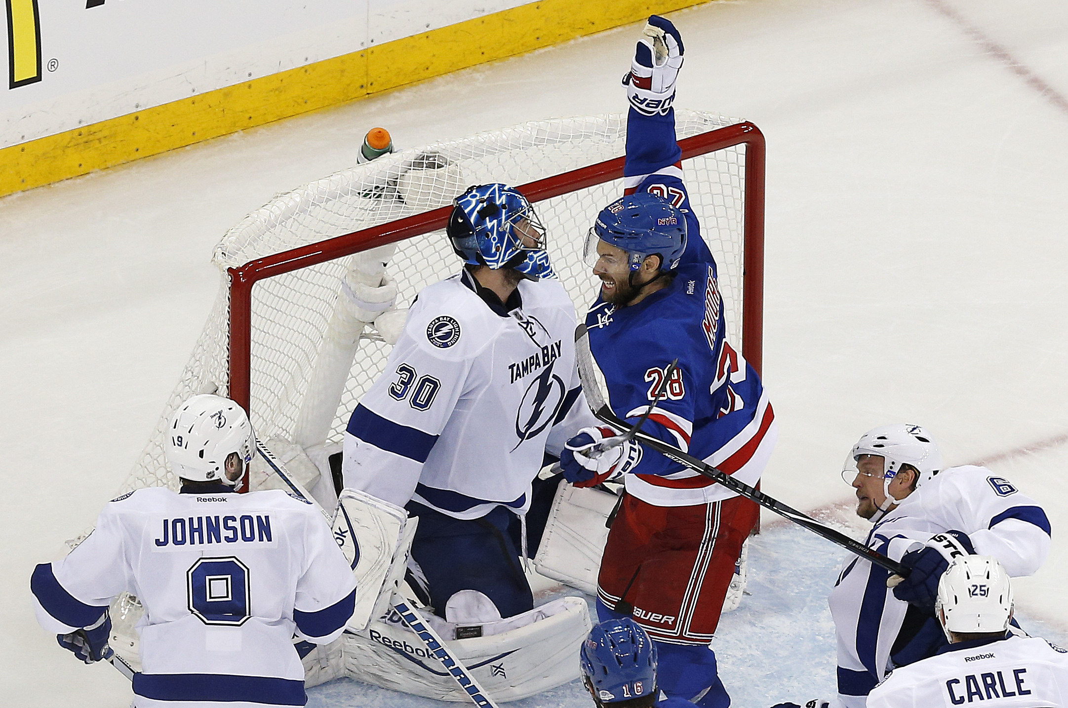 New York Rangers center Dominic Moore (28) celebrates after scoring against the Tampa Bay Lightning during the third period of Game 1 of the Eastern Conference final during the NHL hockey Stanley Cup playoffs, Saturday, May 16, 2015, in New York. The Rang
