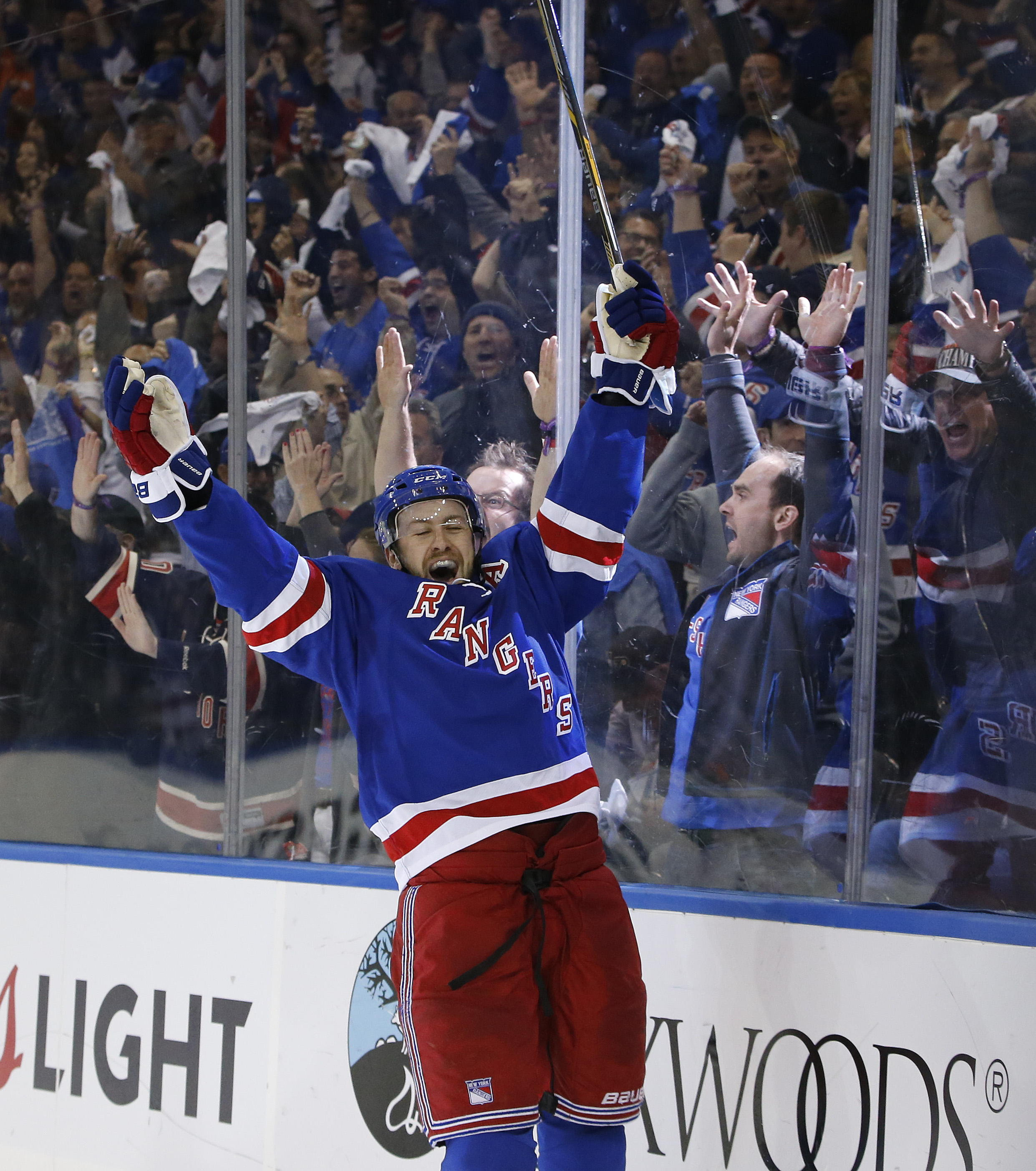 New York Rangers center Derek Stepan (21) celebrates his second period goal against the Tampa Bay Lightning in Game 1 of the Eastern Conference final during the NHL hockey Stanley Cup playoffs, Saturday, May 16, 2015, in New York. The Rangers won 2-1. (AP