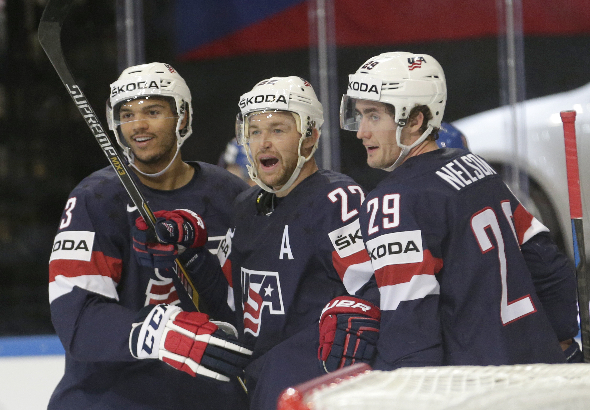 Trevor Lewis, of the United States, center, celebrates with Brock Nelson, right, and Seth Jones, left, after scoring against the Czech Republic during the Hockey World Championships bronze medal match in Prague, Czech Republic, Sunday, May 17, 2015. (AP P