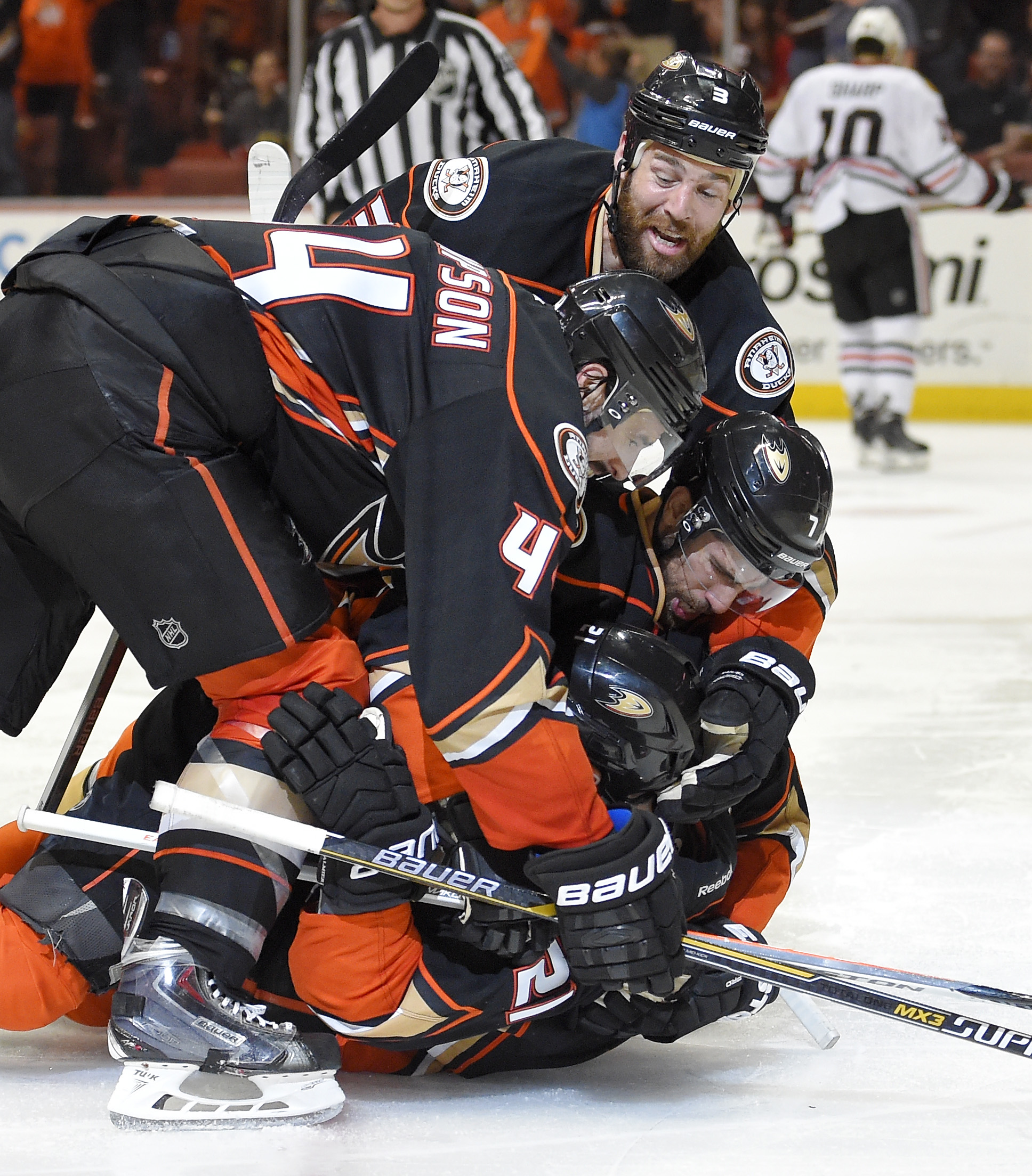 Teammates celebrate with Anaheim Ducks right wing Kyle Palmieri, bottom, after his goal during the second period in Game 1 of a Western Conference finals hockey series against the Chicago Blackhawks, Sunday, May 17, 2015, in Anaheim, Calif. (AP Photo/Mark