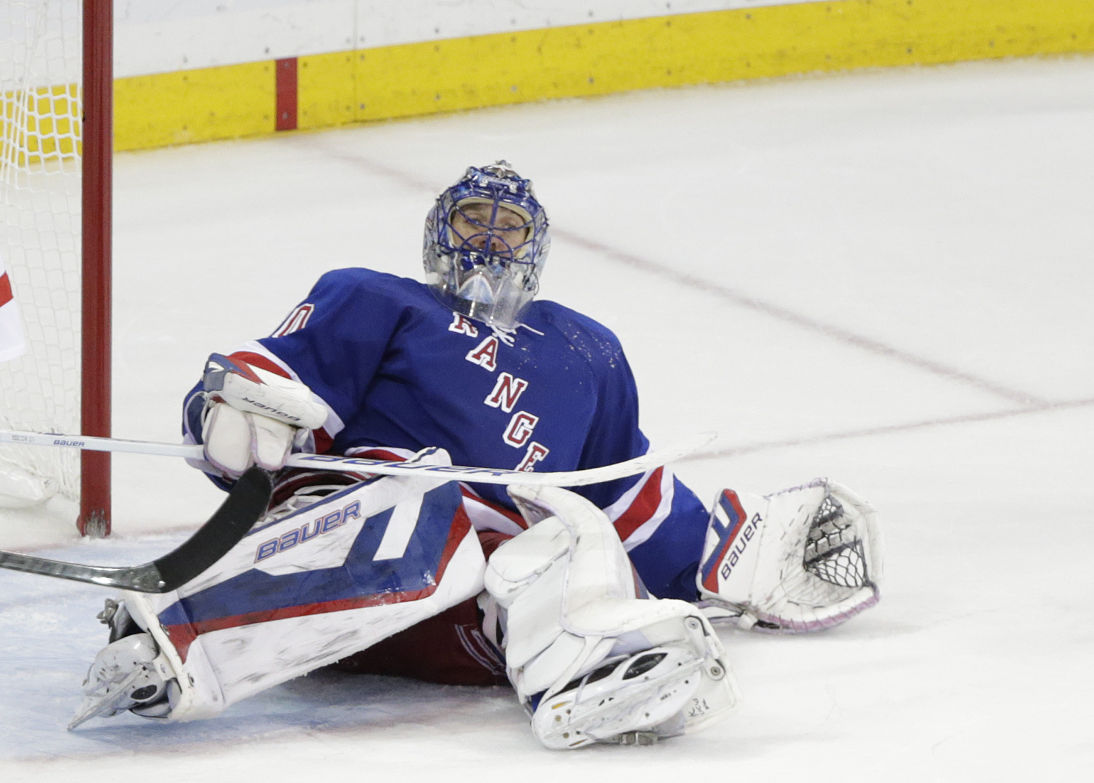 New York Rangers goalie Henrik Lundqvist rolls onto his back after giving up a goal to the Tampa Bay Lightning during the third period of Game 2 of the Eastern Conference final during the NHL hockey Stanley Cup playoffs, Monday, May 18, 2015, in New York.