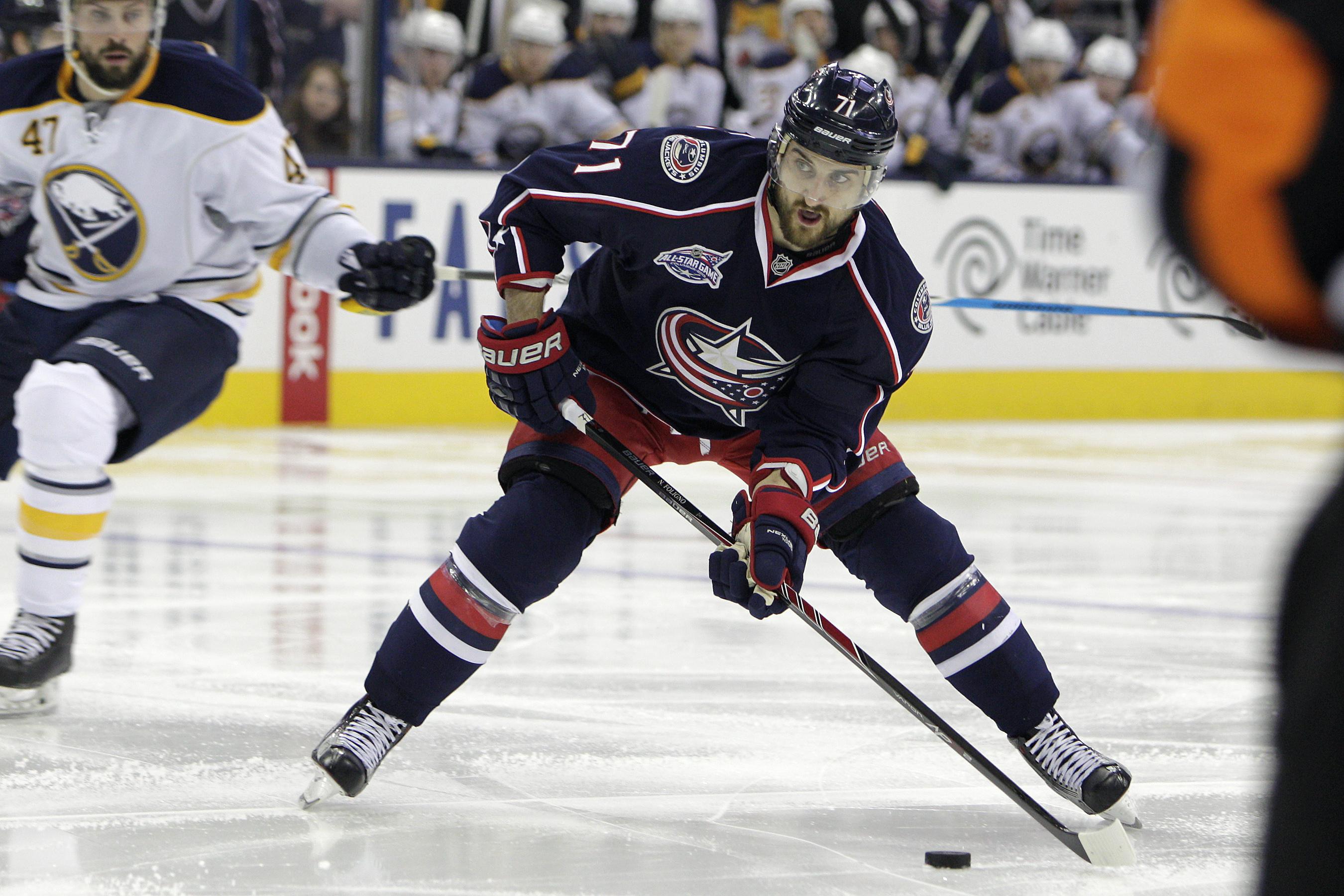 FILE-This Friday, April 10, 2015, file photo shows Columbus Blue Jackets' Nick Foligno playing against the Buffalo Sabres during an NHL hockey game in Columbus, Ohio. Without a captain for three years since Rick Nash was traded away, the Columbus Blue Jac