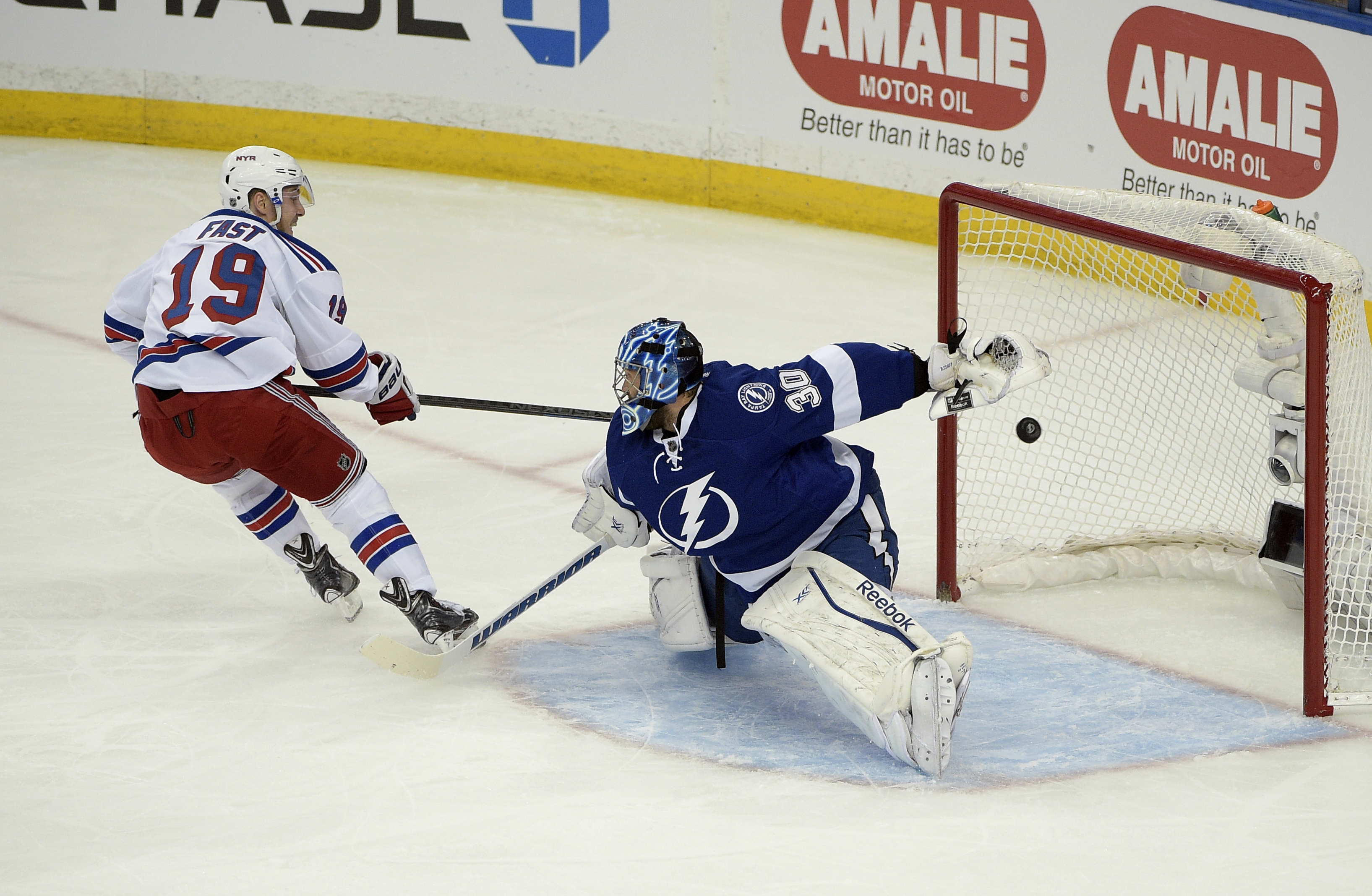 New York Rangers right wing Jesper Fast (19), of Sweden, watches his goal against Tampa Bay Lightning goalie Ben Bishop (30) during the first period of Game 3 of the Eastern Conference finals of th NHL hockey Stanley Cup playoffs, Wednesday, May 20, 2015,