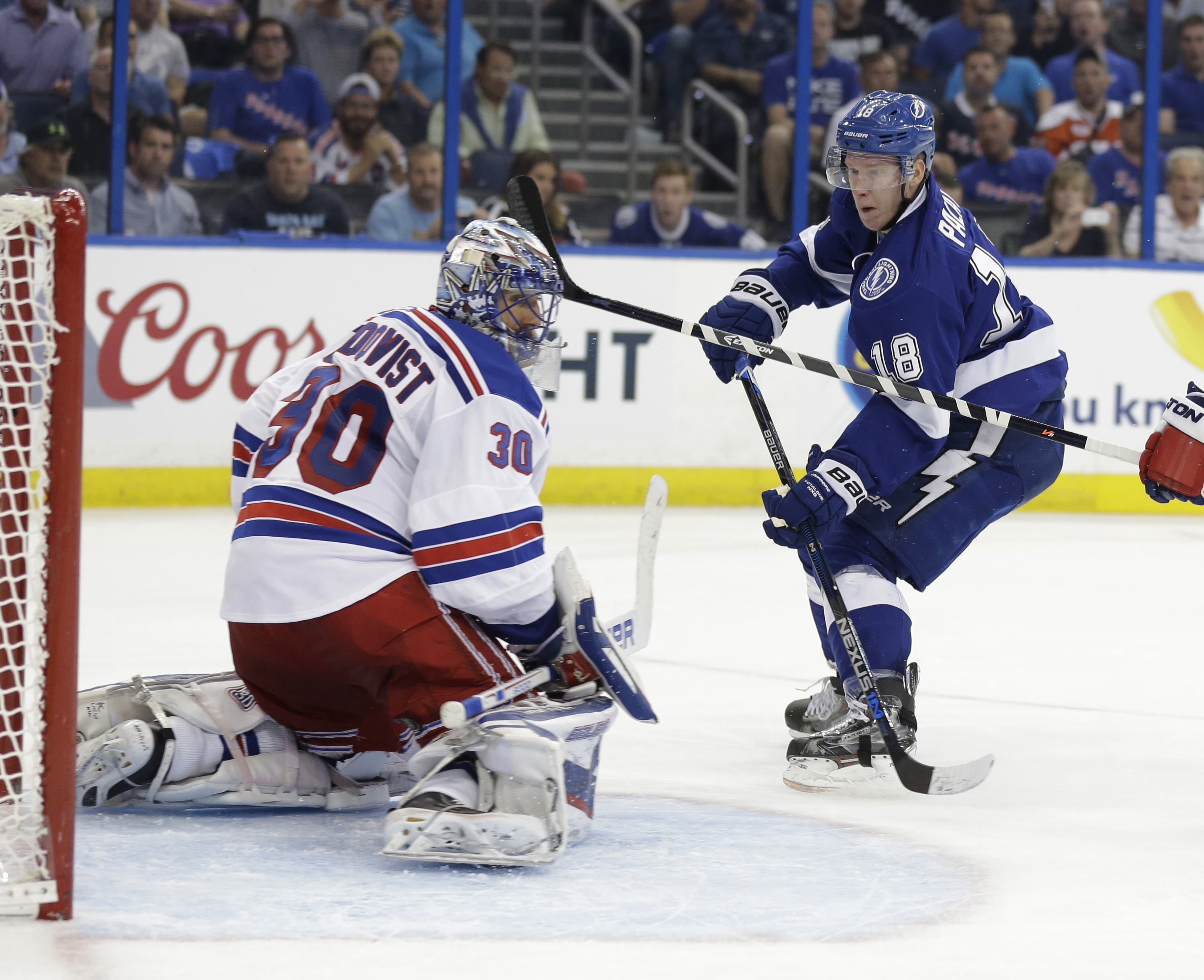 New York Rangers goalie Henrik Lundqvist (30), of Sweden, looks back as Tampa Bay Lightning left wing Ondrej Palat (18), of the Czech Republic, scores during the second period of Game 3 of the Eastern Conference finals, in the NHL hockey Stanley Cup playo