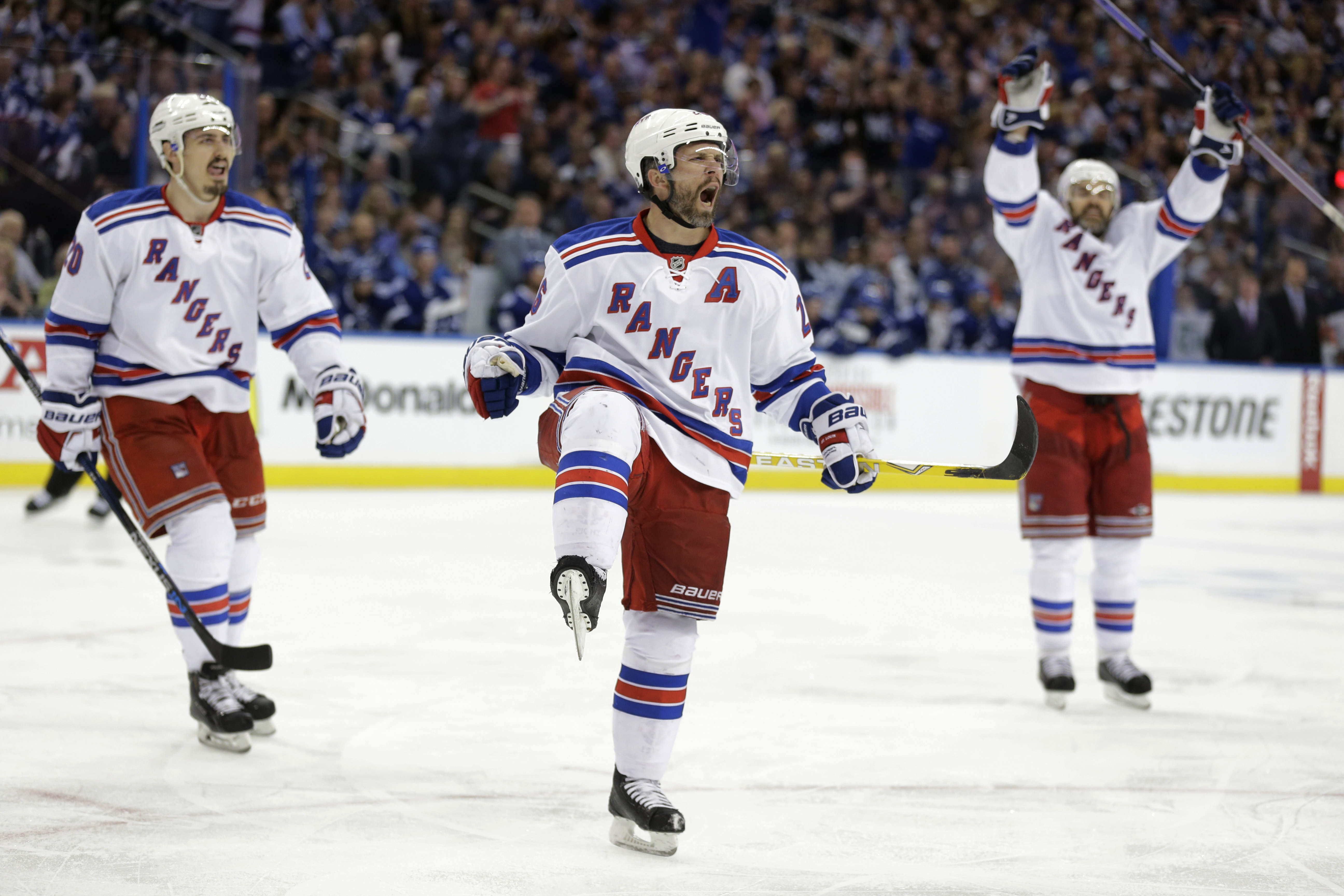 New York Rangers right wing Martin St. Louis, center, celebrates after scoring a goal during the third period of Game 4 of the Eastern Conference finals against the Tampa Bay Lightning, in the NHL hockey Stanley Cup playoffs, Friday, May 22, 2015, in Tamp
