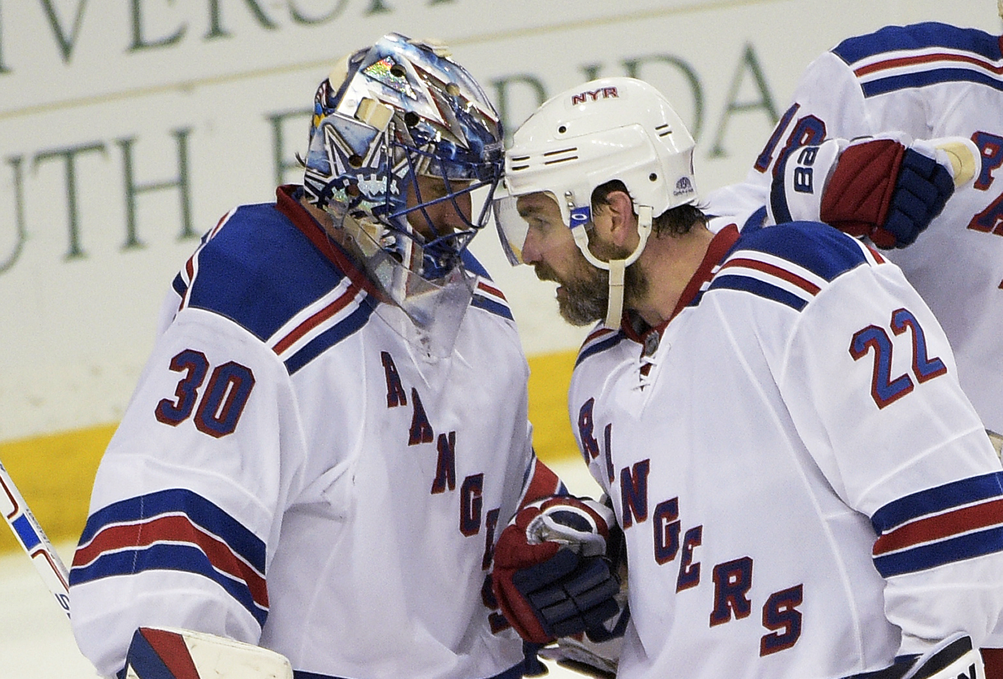 New York Rangers goalie Henrik Lundqvist (30), of Sweden, and defenseman Dan Boyle (22) congratulate each other after the Rangers defeated the Tampa Bay Lightning 5-1 in Game 4 of the Eastern Conference finals of the NHL hockey Stanley Cup playoffs, Frida