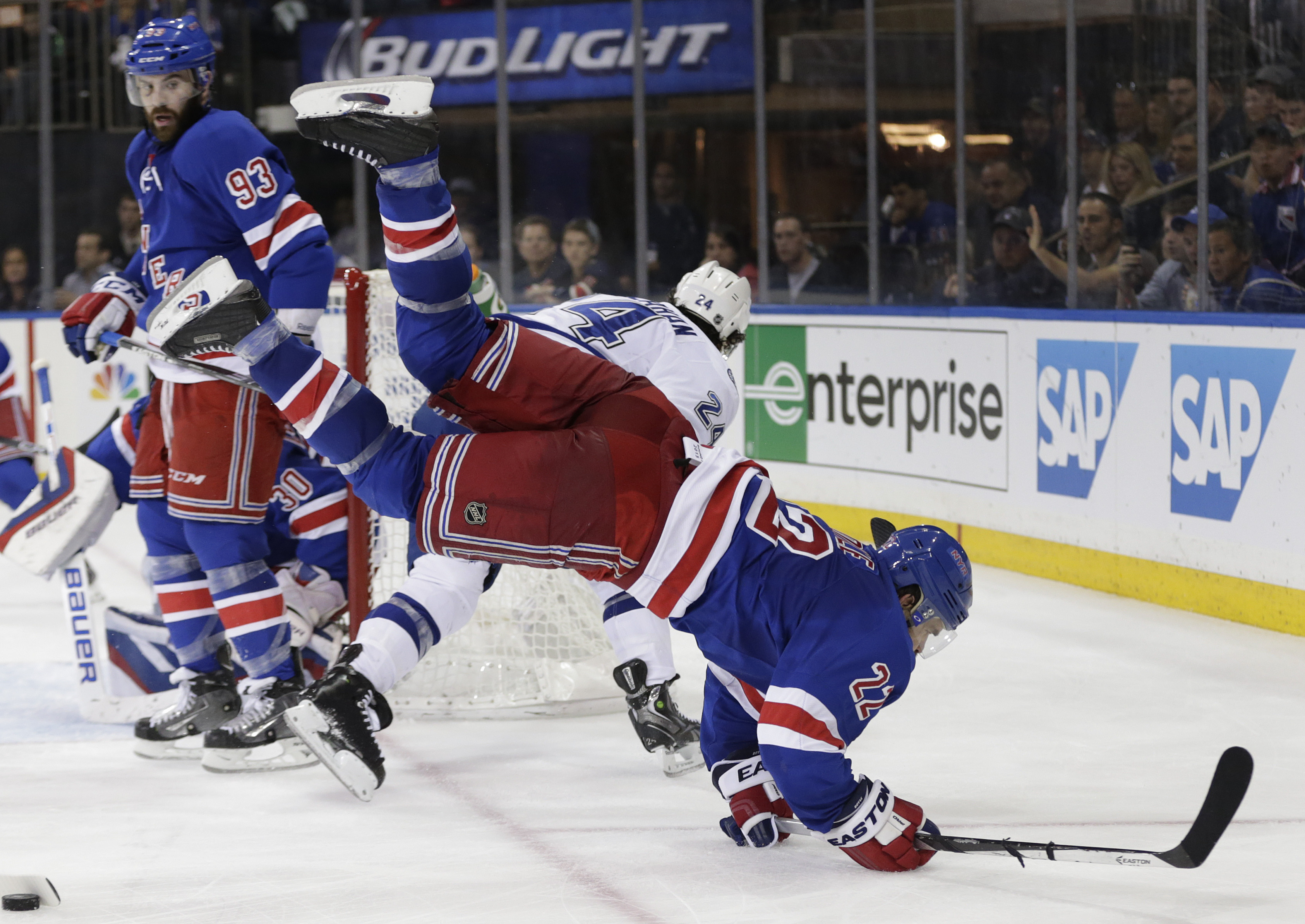 New York Rangers defenseman Dan Boyle (22) collides with Tampa Bay Lightning right wing Ryan Callahan (24) during the third period of Game 5 of the Eastern Conference final during the NHL hockey Stanley Cup playoffs, Sunday, May 24, 2015, in New York. The