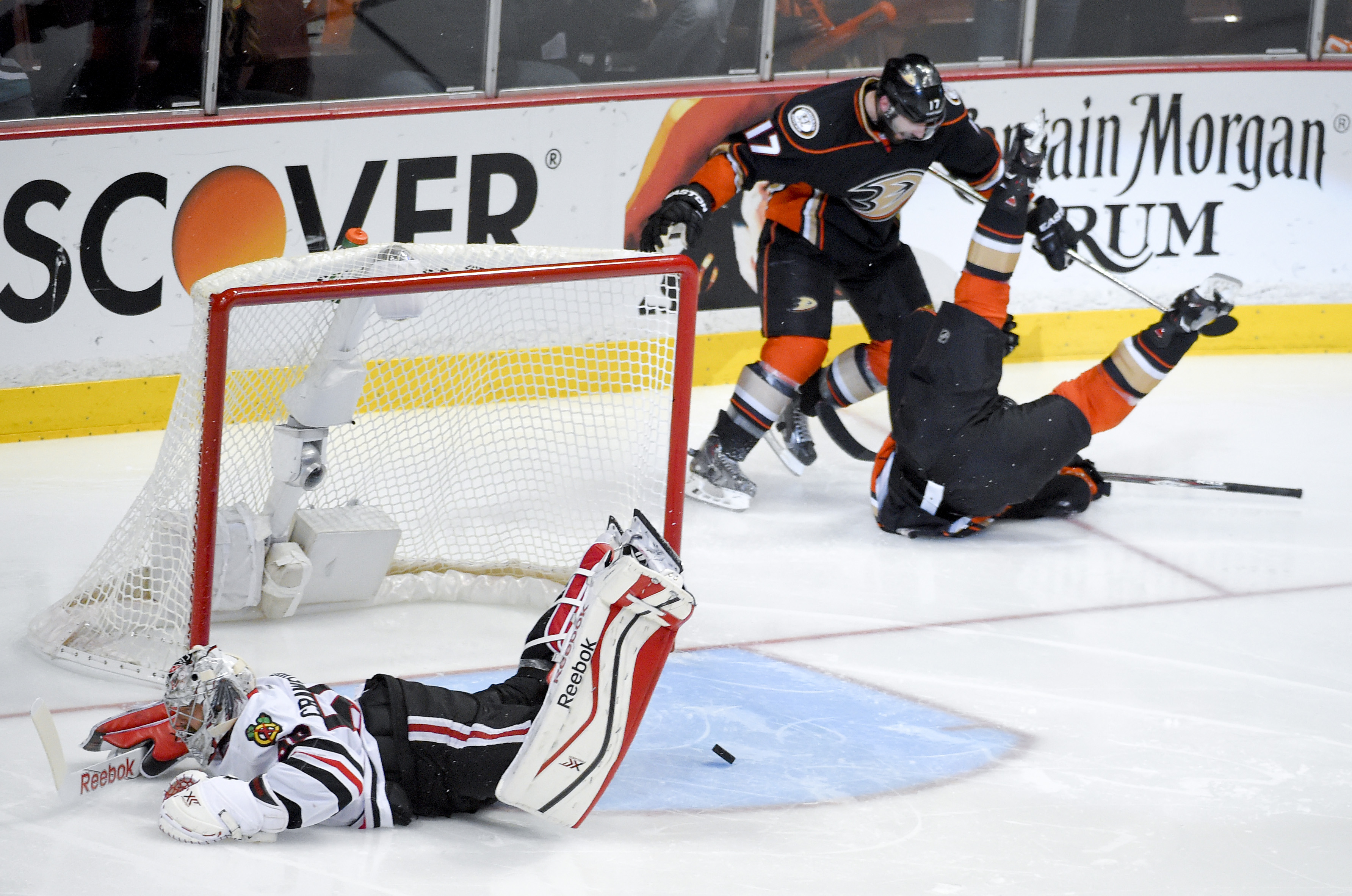 Anaheim Ducks left wing Matt Beleskey right, celebrates with Ryan Kesler after scoring the game winning goal past Chicago Blackhawks goalie Corey Crawford, left, during overtime in Game 5 of the Western Conference final of the NHL hockey Stanley Cup playo