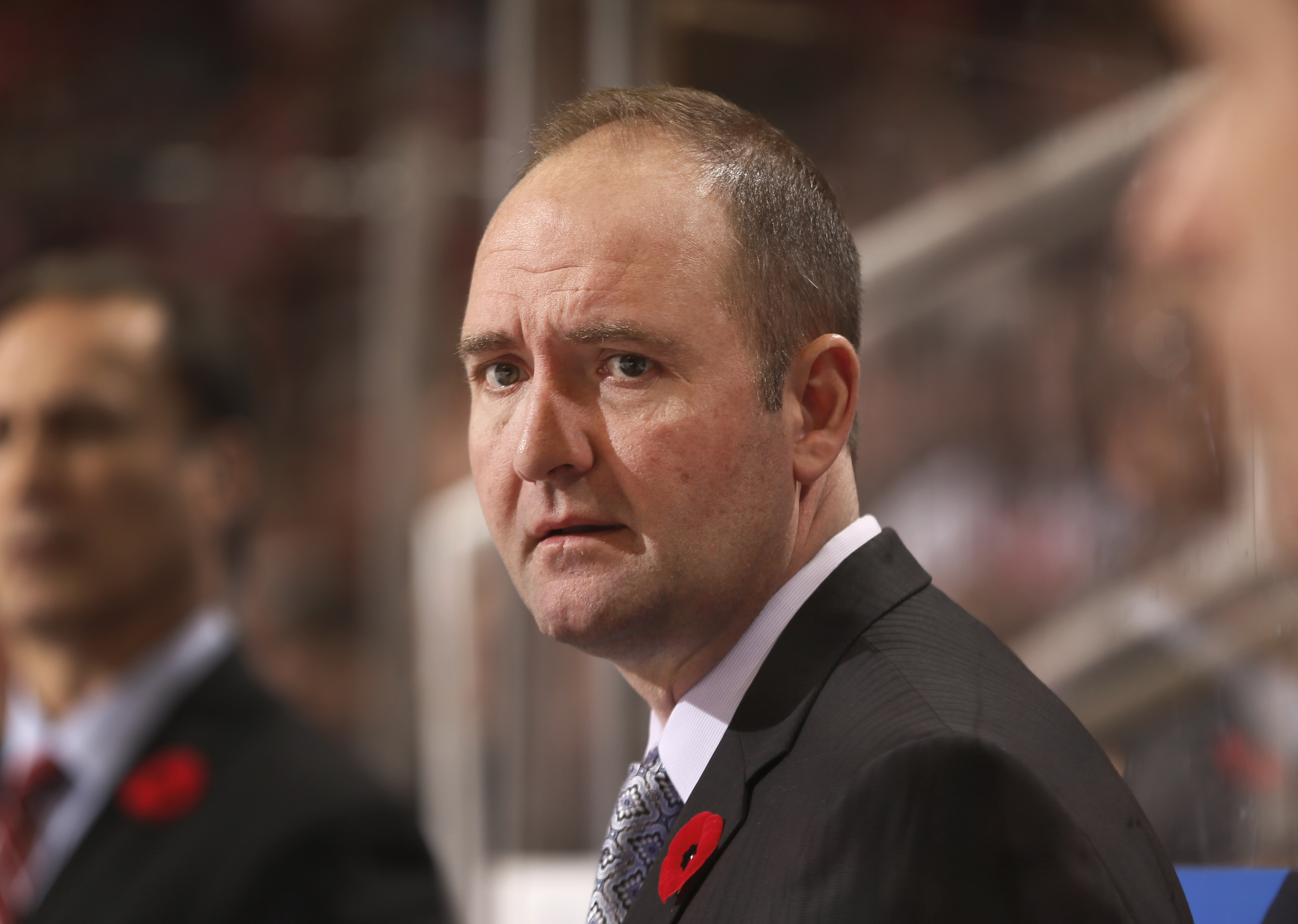 FILE - In this Nov. 7, 2014, file photo, then-New Jersey Devils head coach Peter DeBoer watches the second period of an NHL hockey game against the Detroit Red Wings in Detroit. The San Jose Sharks will hire Peter DeBoer as their new head coach.  A person