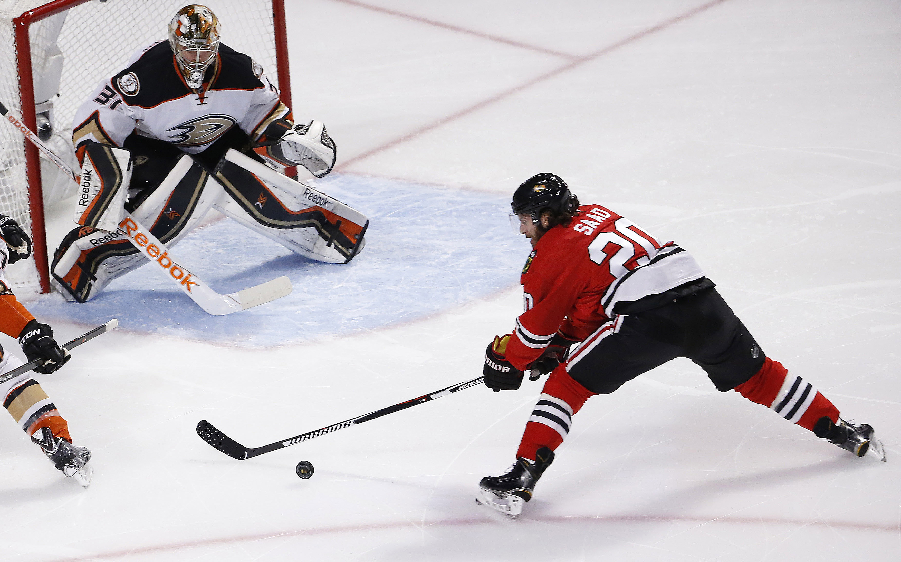 Chicago Blackhawks left wing Brandon Saad (20) shoots on Anaheim Ducks goalie Frederik Andersen (31) during the first period in Game 6 of the Western Conference finals of the NHL hockey Stanley Cup playoffs, Wednesday, May 27, 2015, in Chicago. (AP Photo/