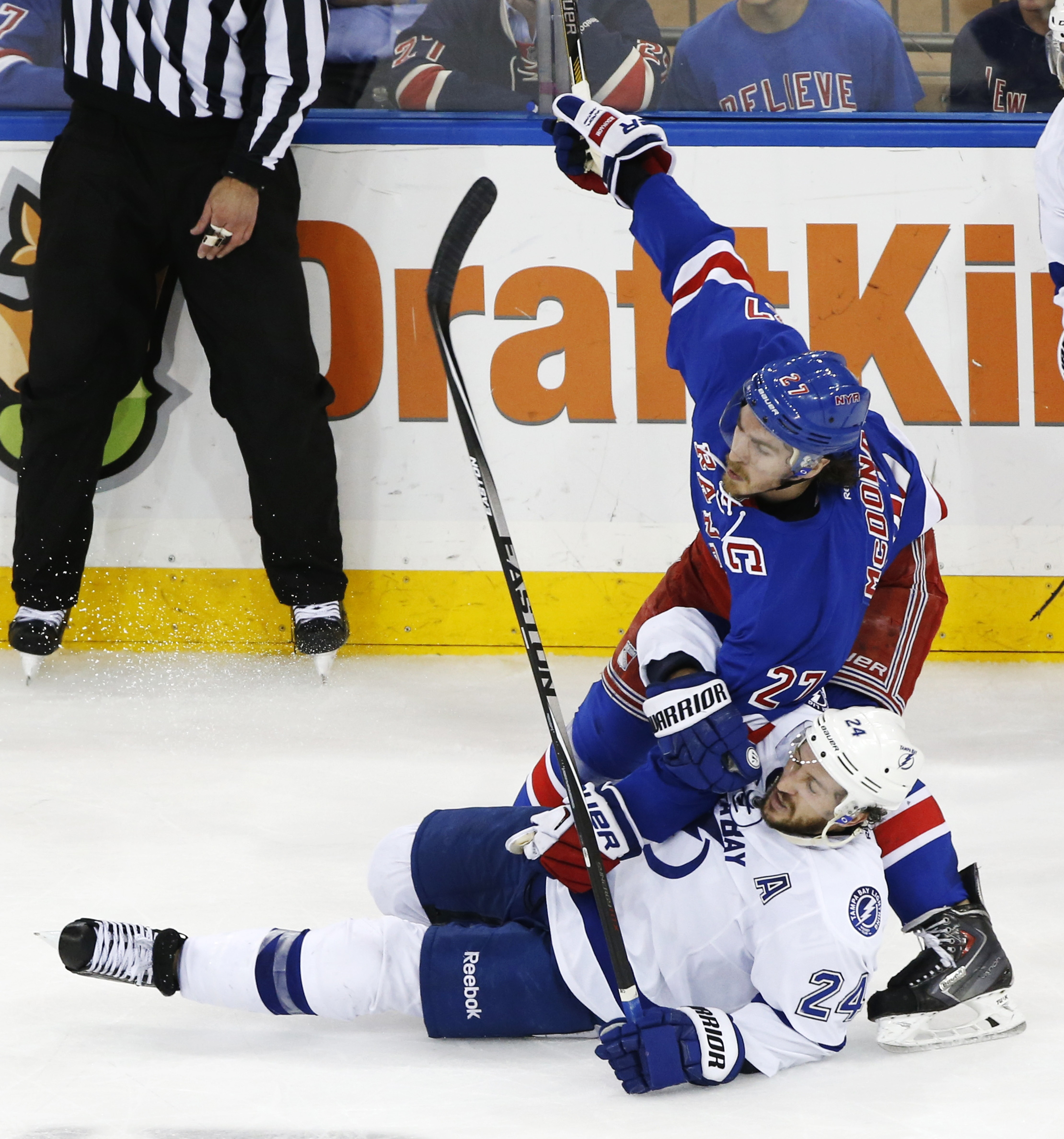 New York Rangers defenseman Ryan McDonagh (27) collides with Tampa Bay Lightning right wing Ryan Callahan (24) during the third period of Game 7 of the Eastern Conference final during the NHL hockey Stanley Cup playoffs, Friday, May 29, 2015, in New York.