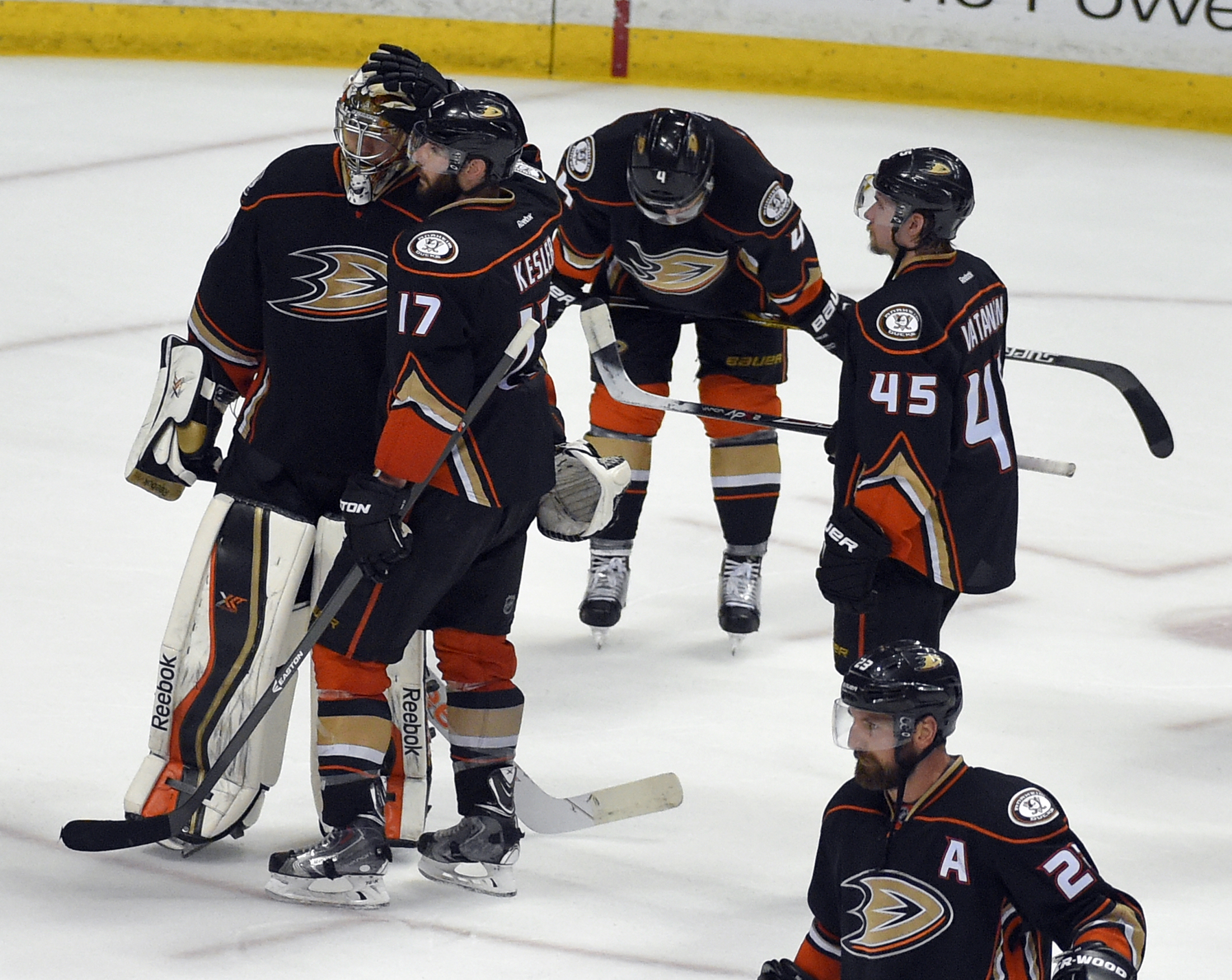Members of the Anaheim Ducks react to their loss against the Chicago Blackhawks in Game 7 of the Western Conference final of the NHL hockey Stanley Cup playoffs in Anaheim, Calif., Saturday, May 30, 2015. The Blackhawks won 5-3 to advance to Stanley Cup F
