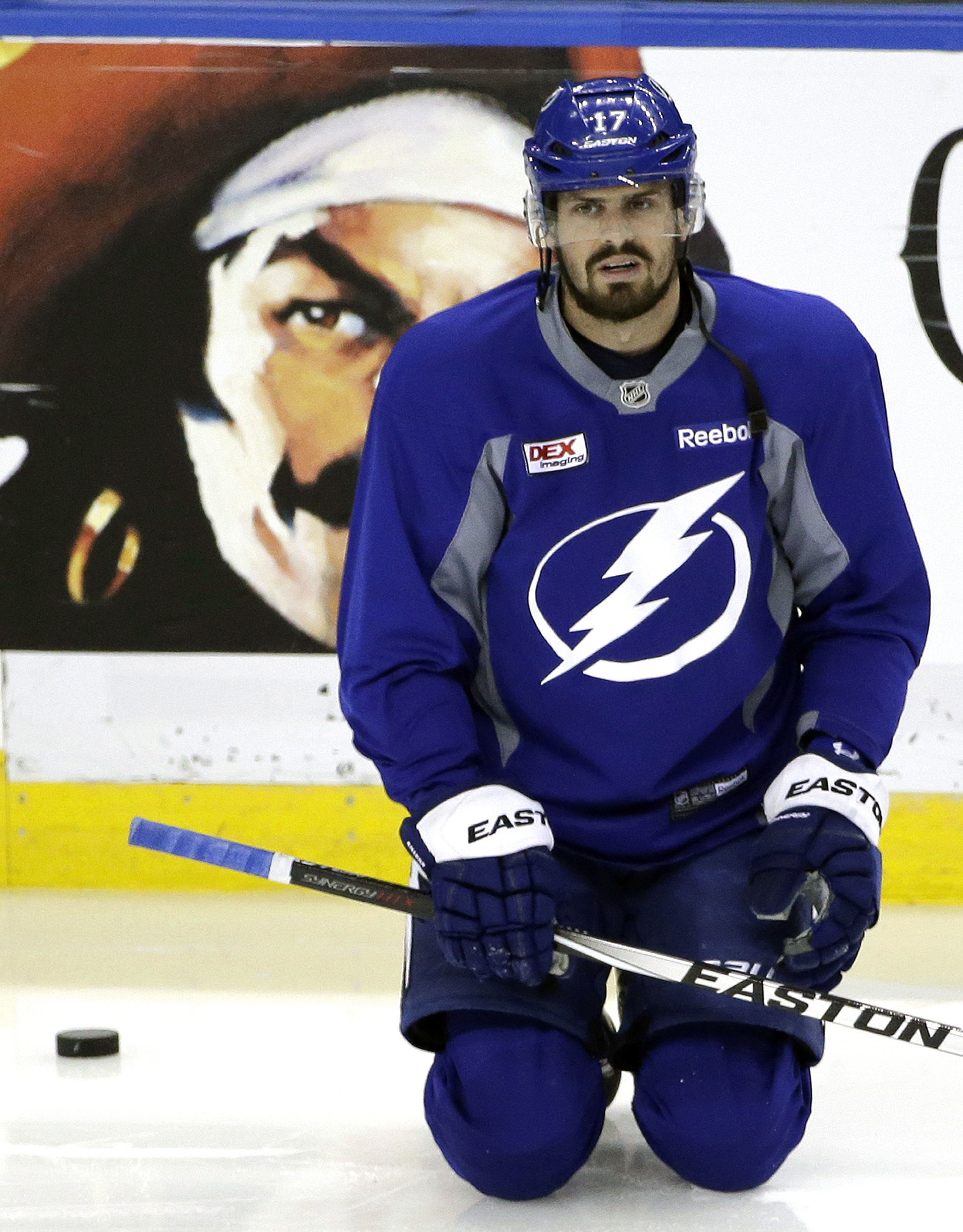 Tampa Bay Lightning center Alex Killorn stretches during NHL hockey practice at Amalie Arena for the Stanley Cup Finals, Tuesday, June 2, 2015, in Tampa, Fla. The Lightning will take on the Chicago Blackhawks in Game 1 on Wednesday.  (AP Photo/Chris O'Mea