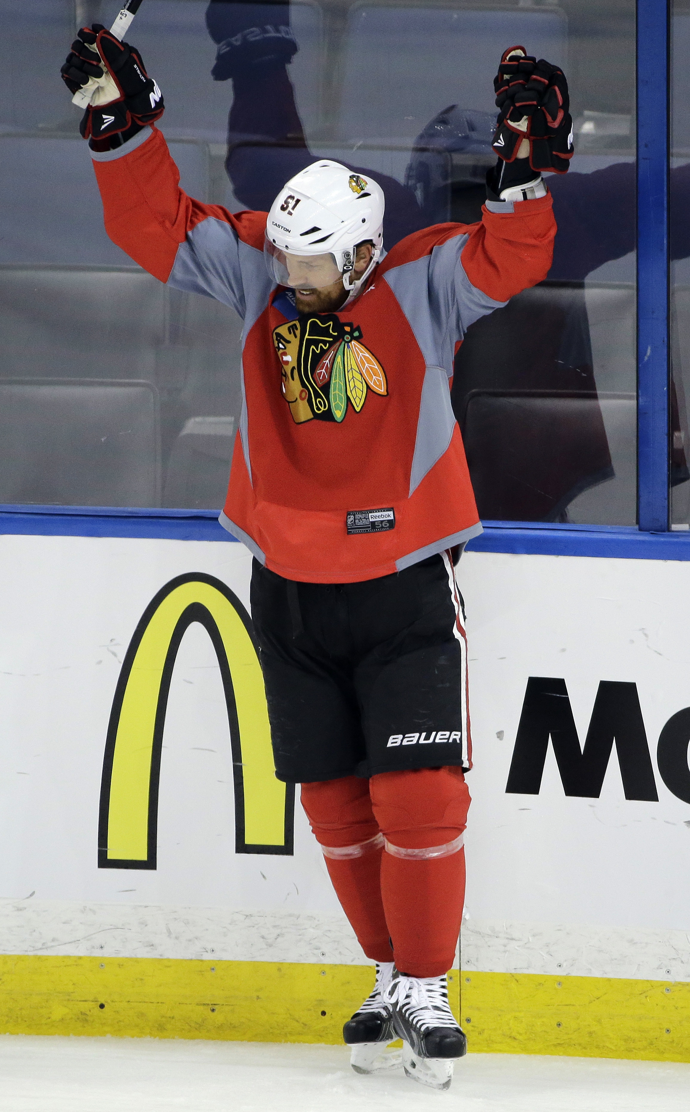 Chicago Blackhawks center Brad Richards celebrates after scoring during NHL hockey practice for the Stanley Cup Finals, Tuesday, June 2, 2015, in Tampa, Fla. The Blackhawks take on the Tampa Bay Lightning in Game 1 on Wednesday.  (AP Photo/Chris O'Meara)
