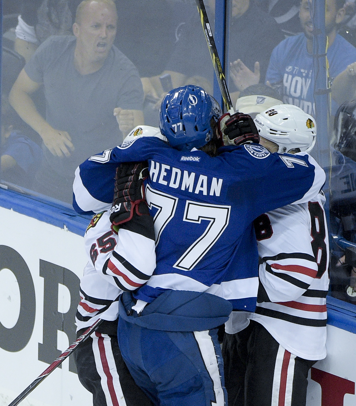 Tampa Bay Lightning defenseman Victor Hedman, middle, said he might have been bitten by Chicago Blackhawks center Andrew Shaw, left, while in a scrum with Patrick Kane during the first period in Game 1 of the NHL hockey Stanley Cup Final in Tampa, Fla., W