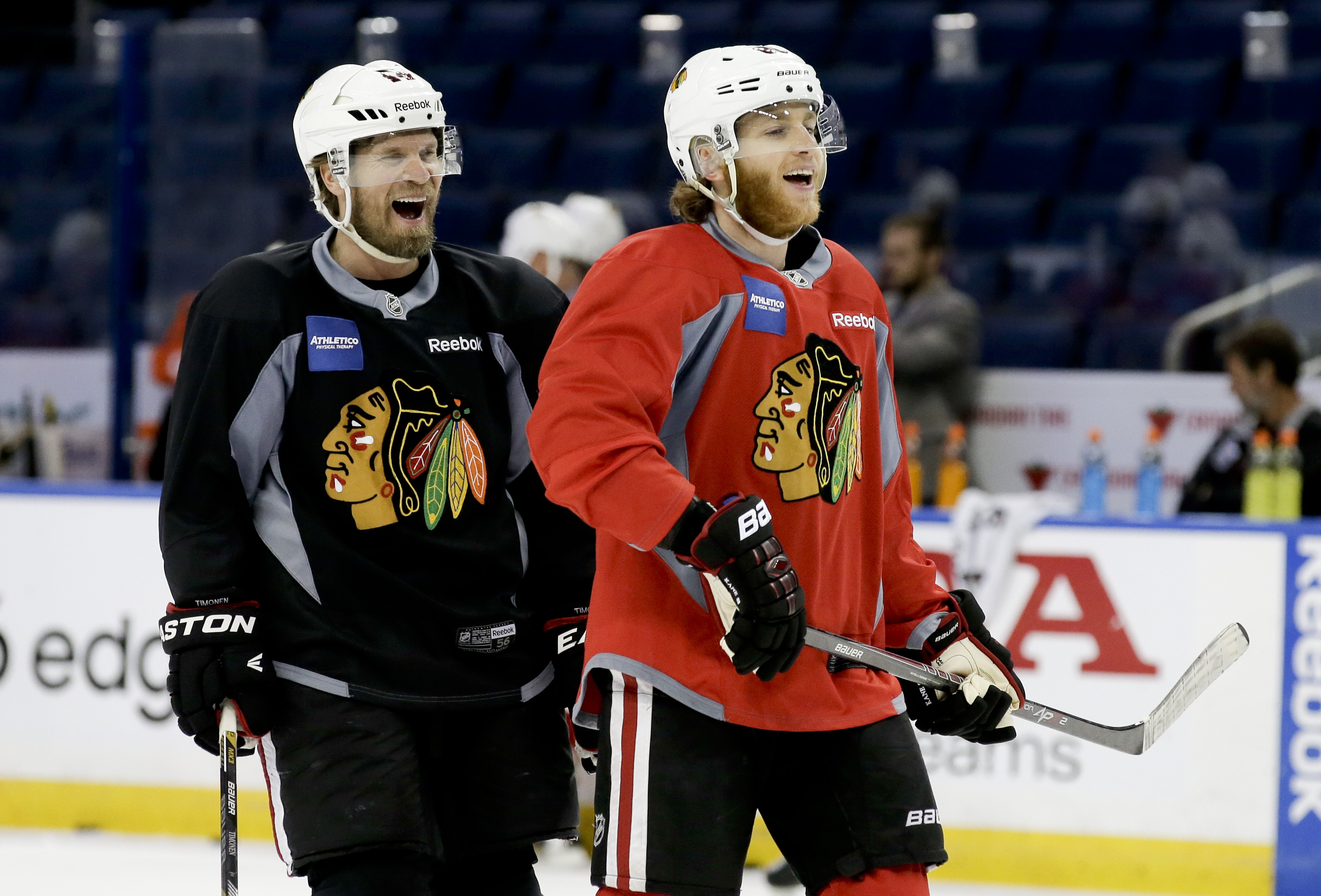 Chicago Blackhawks defenseman Kimmo Timonen, left, right wing Patrick Kane laugh during practice at the NHL hockey Stanley Cup Final, Friday, June 5, 2015, in Tampa, Fla. The Chicago Blackhawks lead the best-of-seven games series against the Tampa Bay Lig