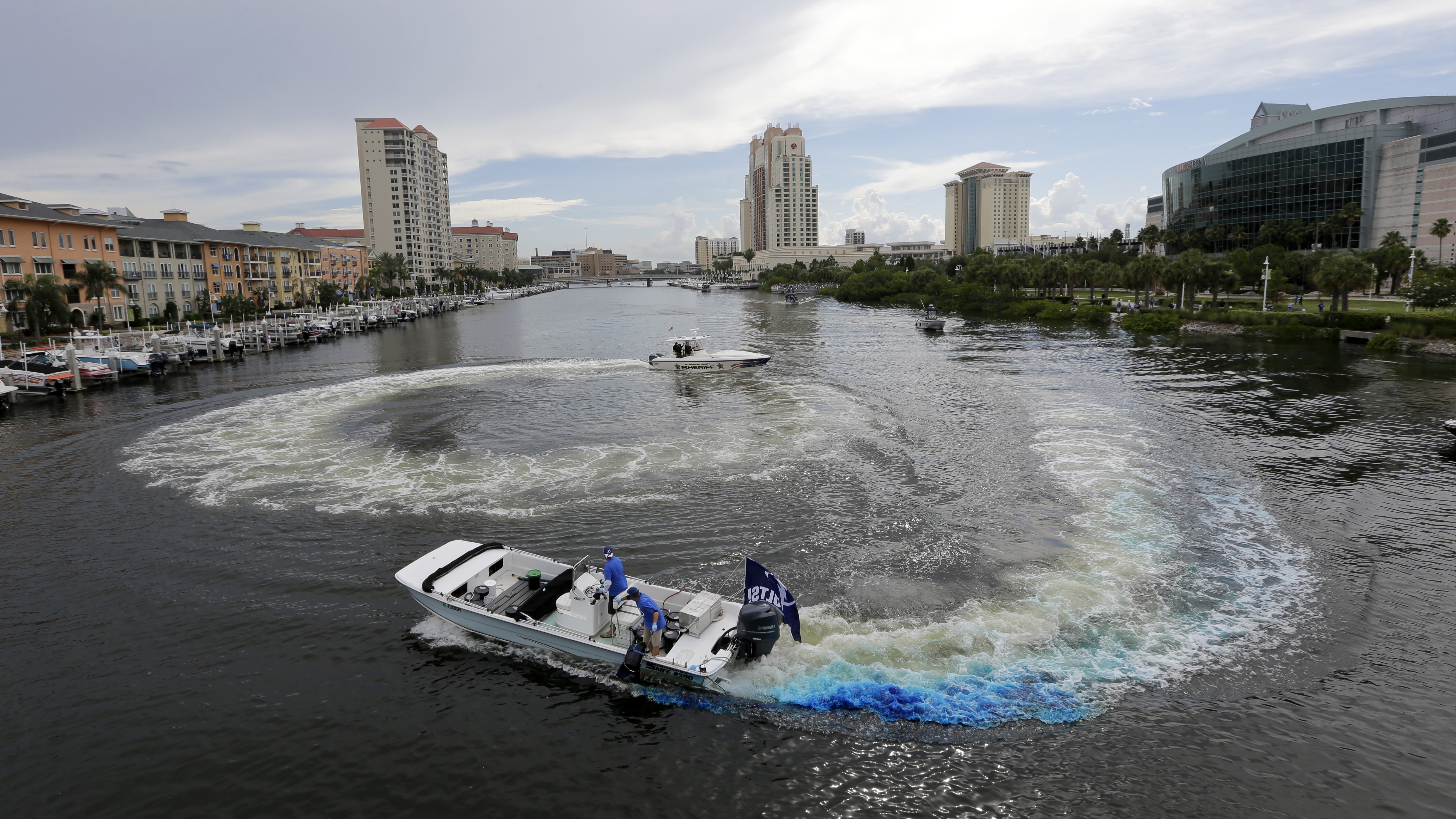 Tampa Bay Lightning supporters dye the Garrison Channel blue outside Amalie Arena before Game 2 of the NHL hockey Stanley Cup Final against the Chicago Blackhawks on Saturday, June 6, 2015, in Tampa Fla. (AP Photo/Chris O'Meara)