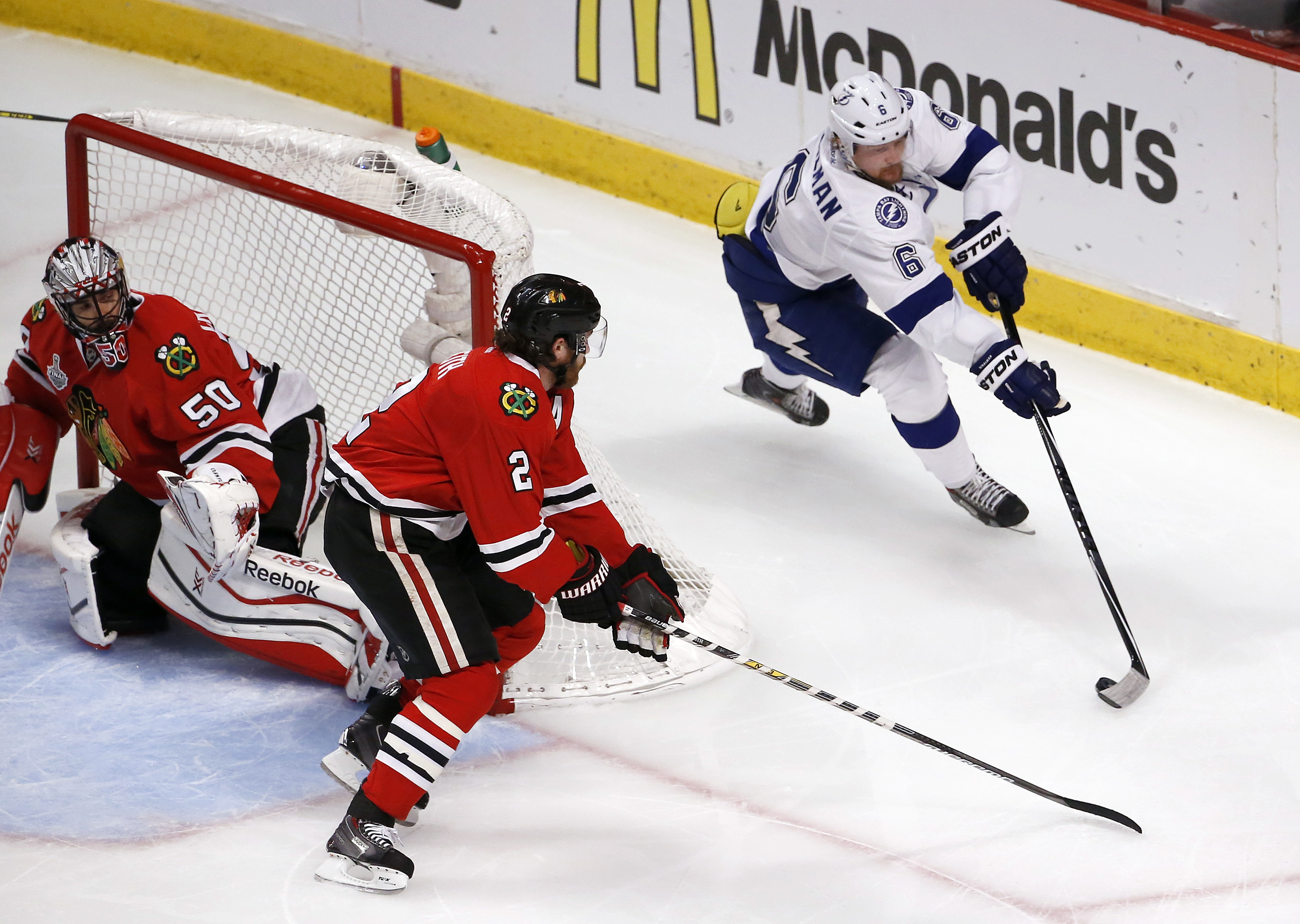 Chicago Blackhawks defenseman Duncan Keith (2) and goalie Corey Crawford (50) defends the goal as Tampa Bay Lightning defenseman Anton Stralman (6) handles the puck during the first period in Game 3 of the NHL hockey Stanley Cup Final on Monday, June 8, 2